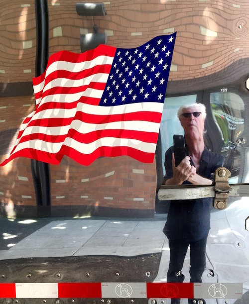 "Self-Portrait with Flag, 2016, archival ink print on paper, 18"" x 13.5"", Editions 20.  Graham Nash looking in fun house mirror , American flag in foreground."