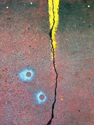 "After Miro, 2014, archival ink print on canvas, 18"" x 13.5"", Editions 4/10.  Red pavement with yellow street marker and crack in the middle of the road."