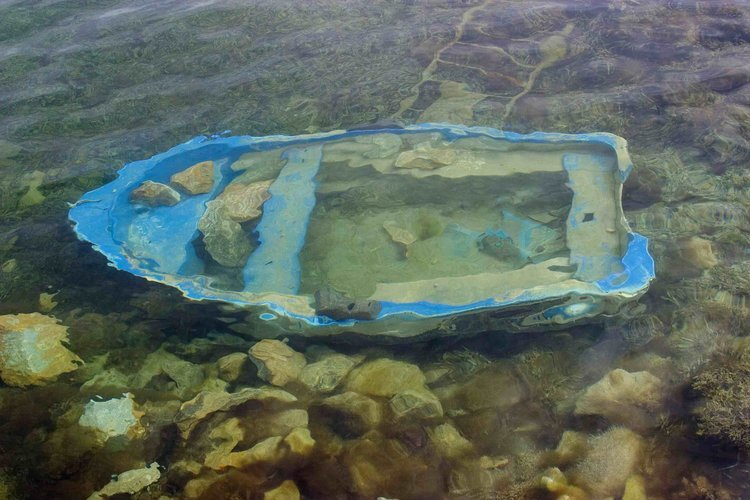 "Blue Boat, 2010, archival ink print on canvas, 24"" x 36"", Edition 4/10.  Abstract photograph of a blue boat sinked inside a river."