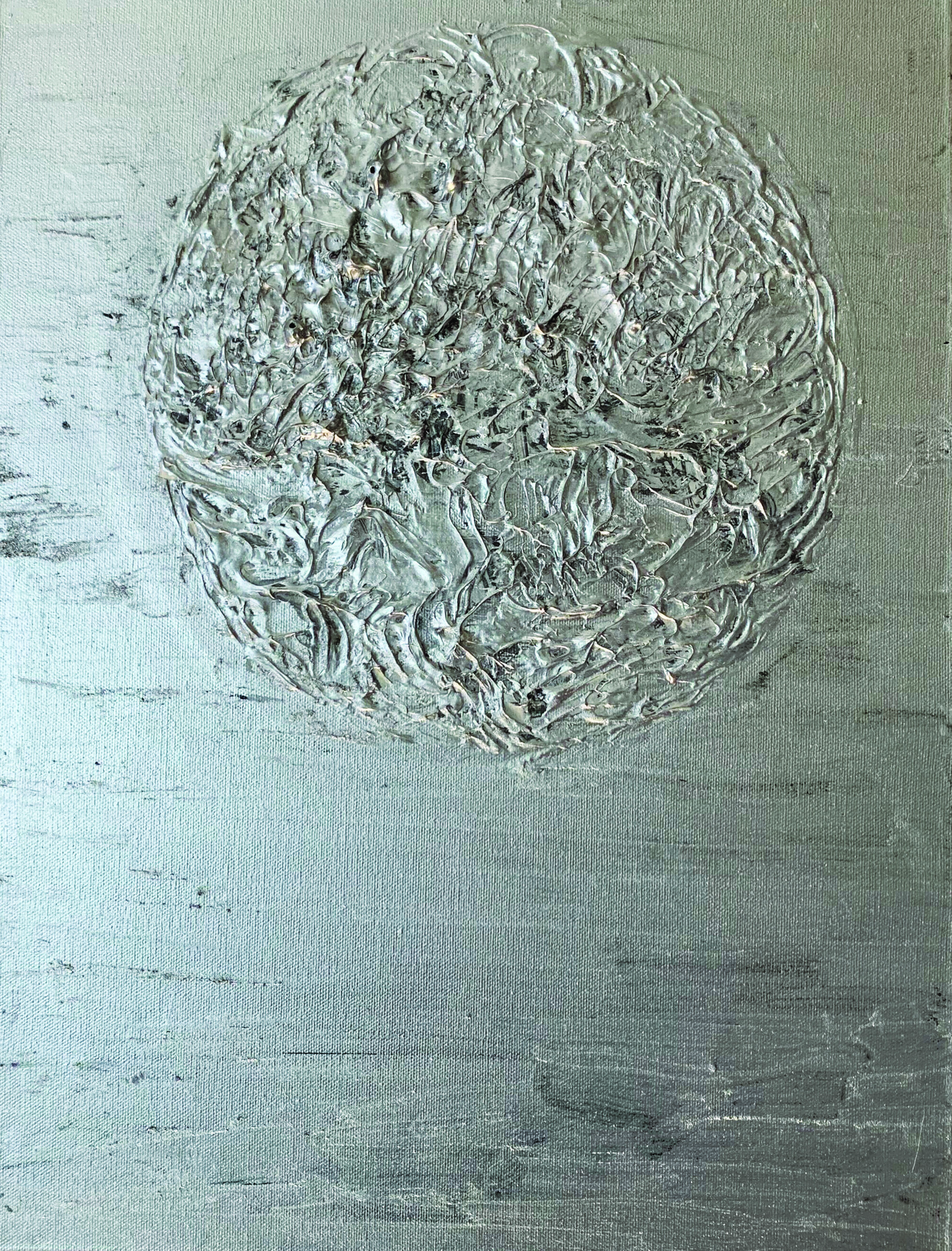 Abstract painting with thickly mounted circle shape in the center, gray and silver background