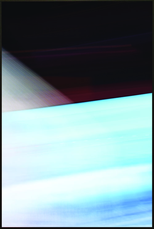 Colorfield vertical abstraction with blue and white in bottom half, black, gray and red in upper half.