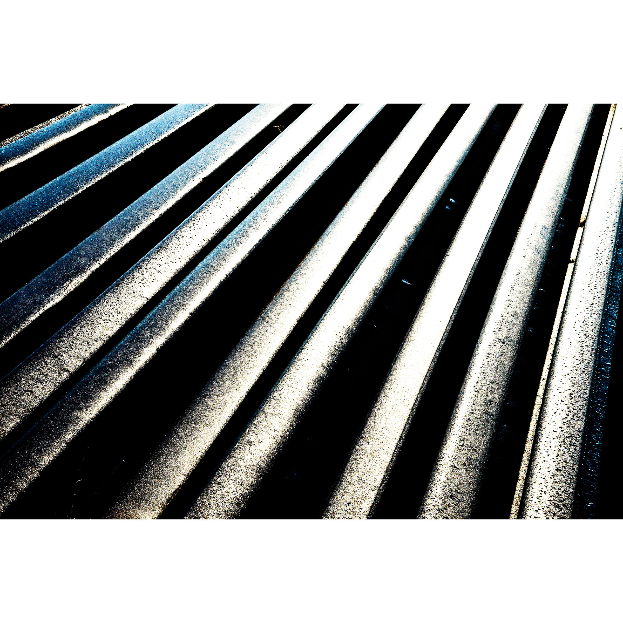 Abstract photography with strong contract of straight lighting with the dark black background.