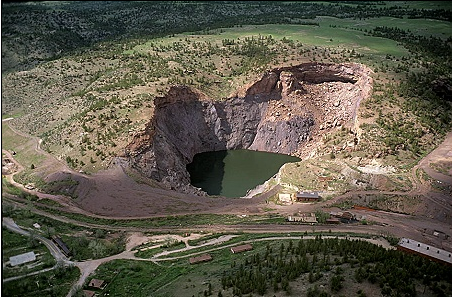 The result of block cave mining, seen in Wyoming.It pales in comparison to the 7000-foot deep pit that Oak Flats might become.