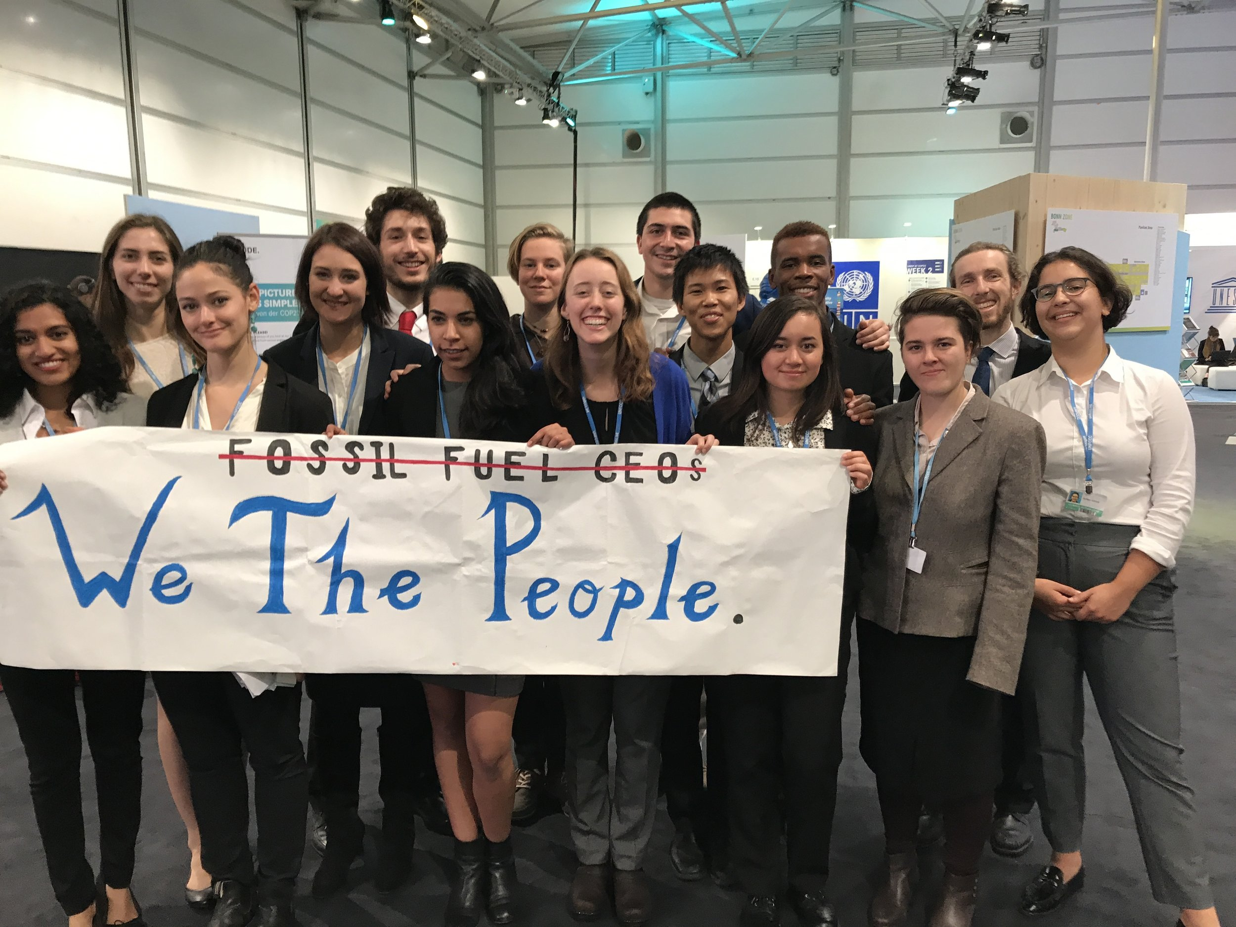 The SustainUS delegation poses for a photo after organizing a mass walk out of the White House fossil fuel panel.