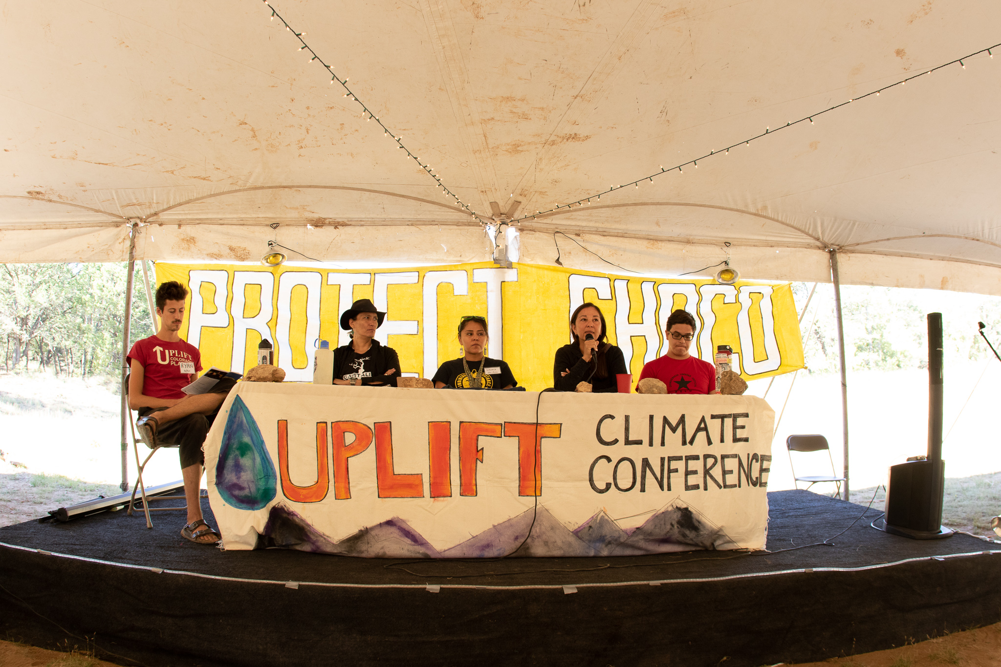 (From left to right) Panelists Klee Benally, Leona Morgan, Nicole Horseherder and Diego Martinez-Lugo discuss extractive economies in the Southwest and potential solutions, on Sept. 15, while Ryan Beam (far left) moderates the conversation. (Photo Credit: Paper Rocket Productions)