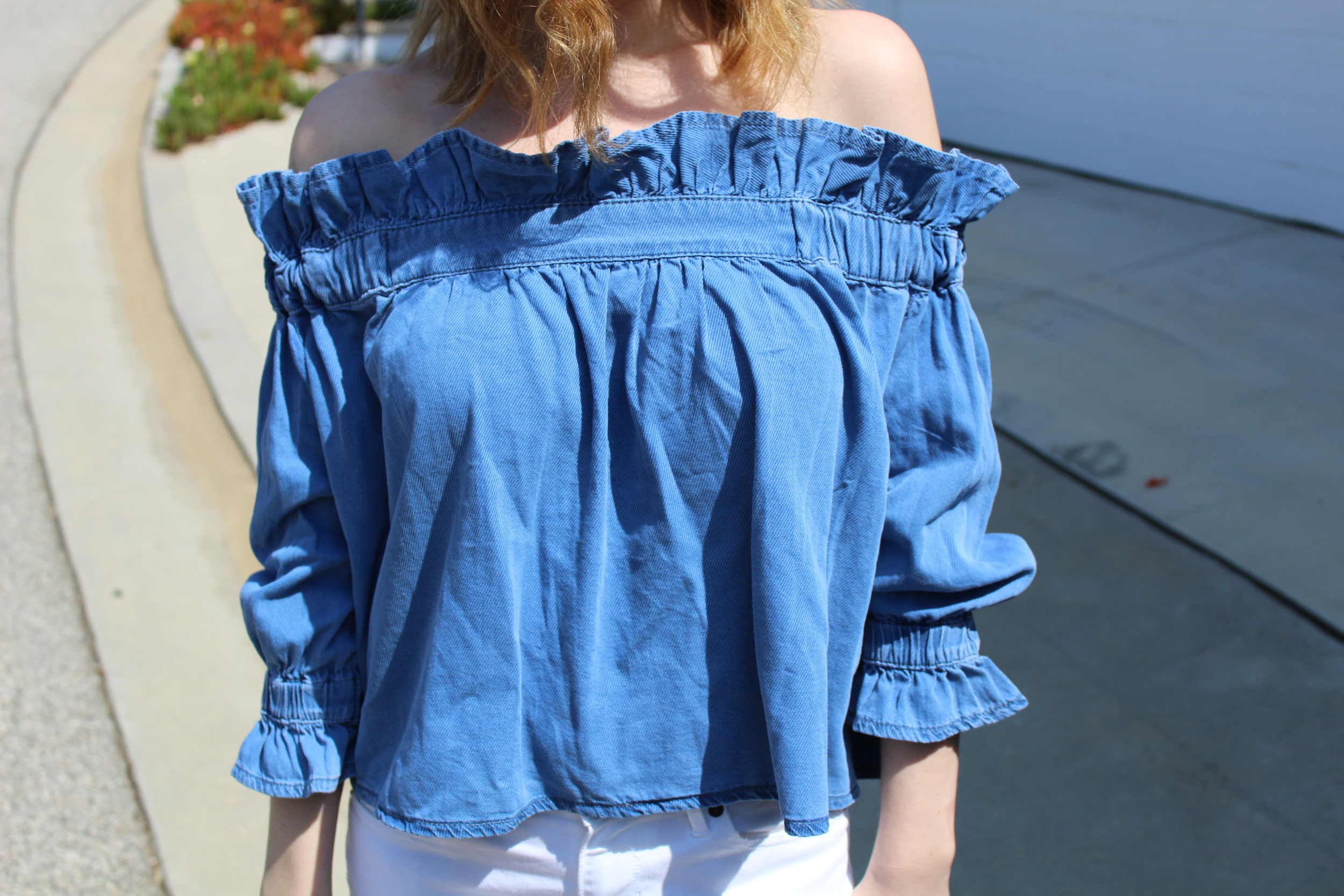 The denim on this off the shoulder top makes it a little more casual but I think it would be easy to dress it up as well if you paired it with darker pants and a heel!