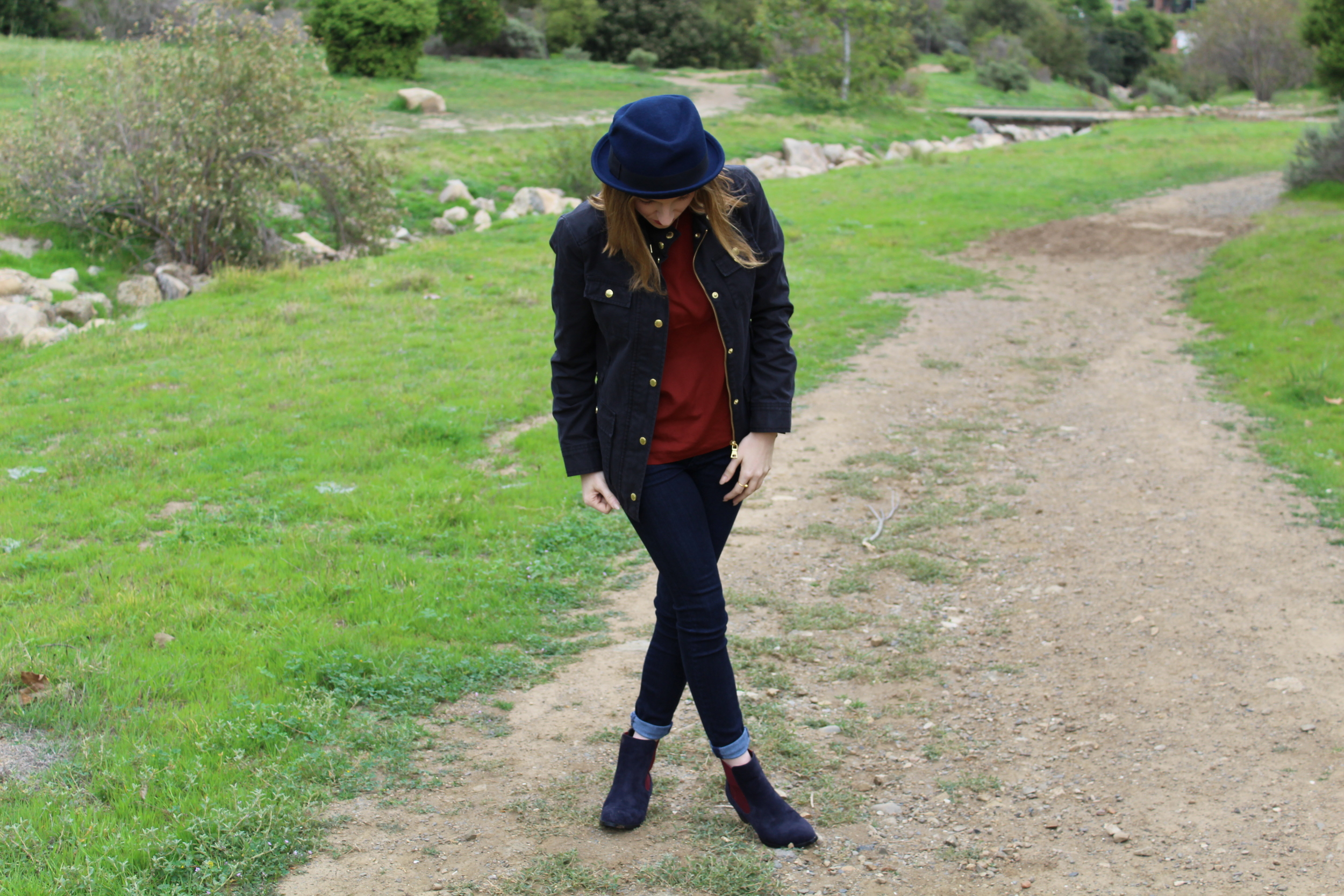 For me, the hat and the shoes are what really tied this look together. The shoes have both navy and red in them which paired great with the jeans and top combo. The jacket is also a dark navy which was perfect, because it was a little rainy this day.