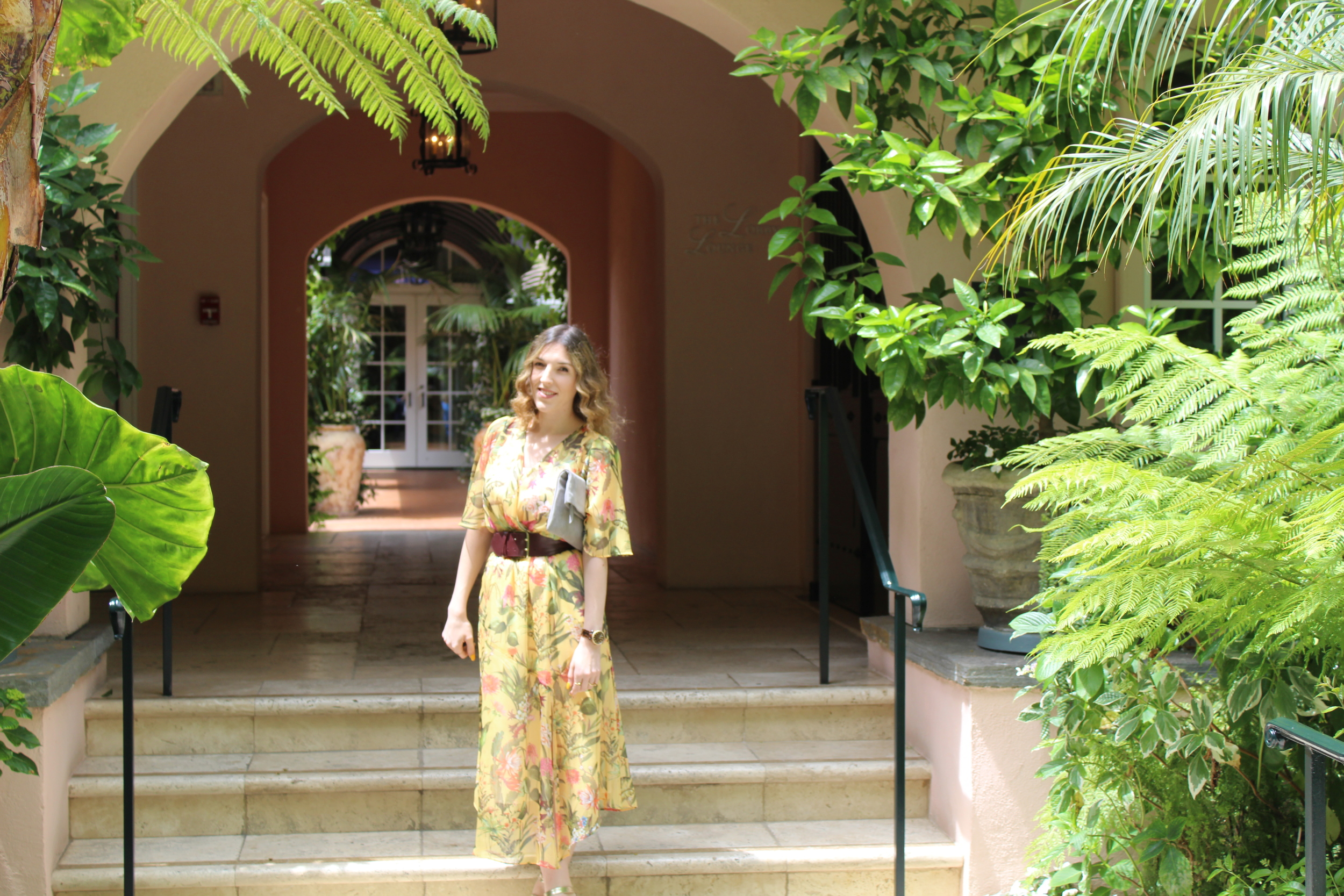 The Hotel Bel-Air is pink and has floral everywhere so I was enjoying taking pictures in this dress. I really like that the dress is yellow with a tropical flower print, which you don't see too often so it made feel really unique but also fresh.  The dress also had an asymmetrical finish which you can't really tell by looking at it but it made it added a cool element to it.