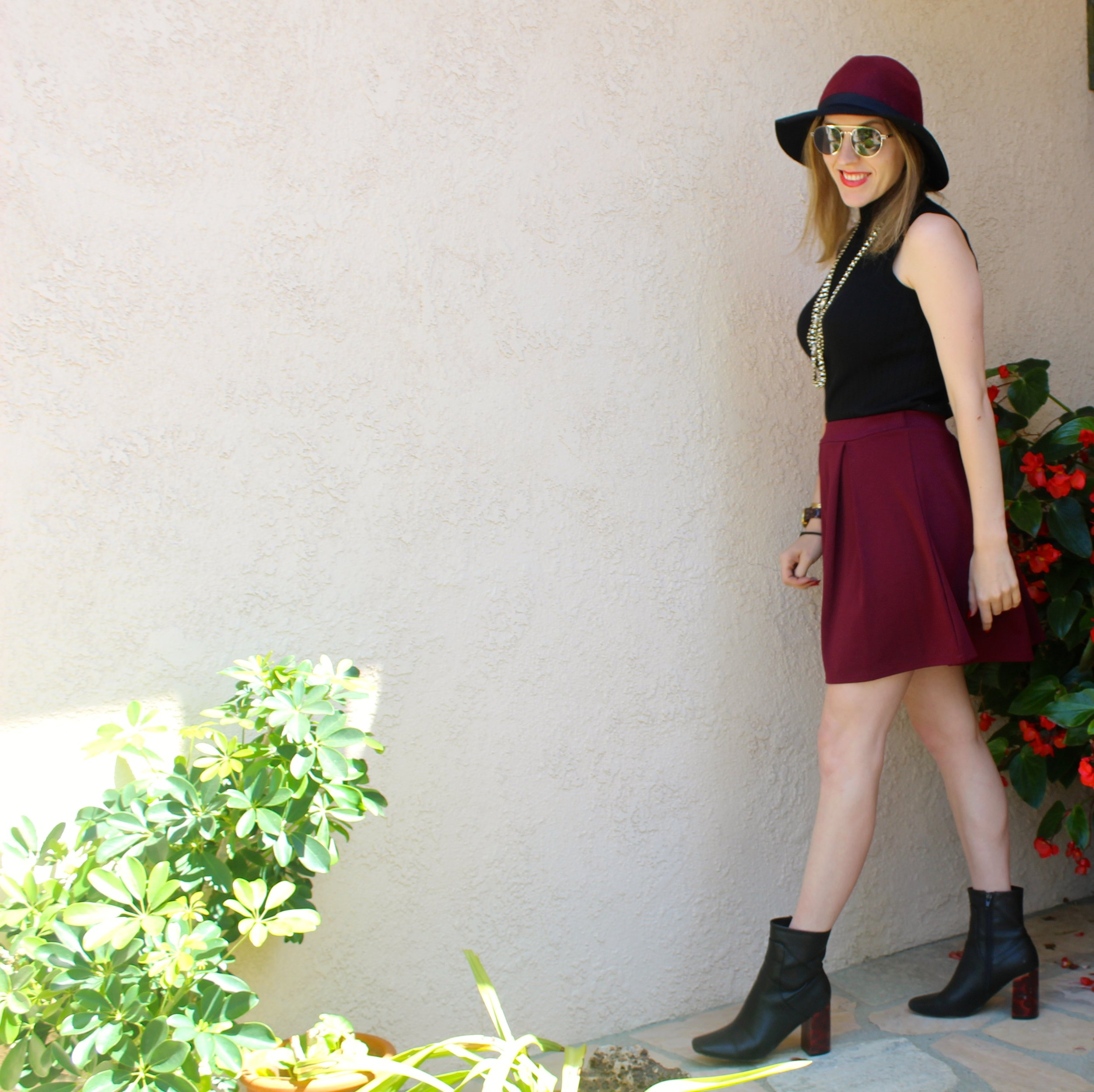 Hat: Charlotte Russe,  similar here  // Top: Banana Republic,  similar here   // Sunnies:  Le Specs  // Skirt:  Boohoo  // Necklace: Banana Republic,  similar here  // Boots:  Lost Ink    Its Wednesday and we are one day away from the start of fall. Although the weather in Los Angeles is still extremely hot, I am looking forward to the cooler weather this season! This look is my version of warm weather fall dressing. The burgundy and black are perfect colors for any fall wardrobe. Adding a turtleneck also makes this look fall inspired. These black tortoise shell boots are one of my favorite pairs of ankle booties. I love where they hit just above the ankle. The bold heel also makes a fashionable statement whenever I wear them and I love that they feel extremely unique! This is an outfit that can easily be taken into colder weather by adding some tights and a long sleeve turtleneck sweater rather than sleeveless. In fact, I will most likely recreate this look in the near future! Stay tuned!  Thanks for stopping by and keep following for more new looks!!! Ciao!!!  xx Nicole