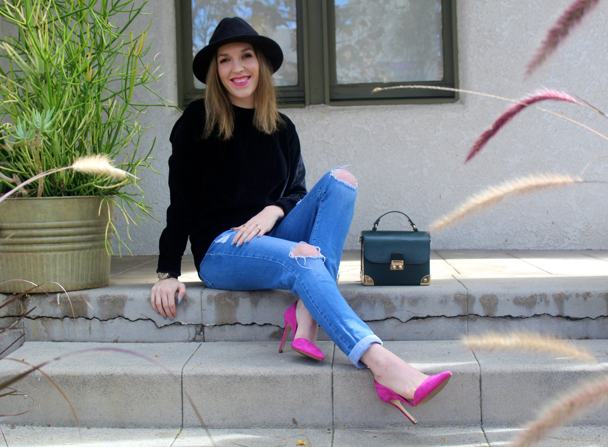 Top:  Boohoo  // Jeans: Flying Monkey,  similar here  // Heels: Banana Republic, simila r here  and  here  // Bag: Forever21, similar  here  // Hat: Goorin Brothers,  similar here    Happy Monday from me! This is a simple look to be put together, with a mix of easy casualness and bright pops of color! I am all about a certain level of comfort when I dress, so a few wardrobe staples like a pair of boyfriend jeans and a nice soft pullover are always welcome! This black velour pullover that I am sporting, is super soft to the touch and right on trend with falls velour and velvet craze! I added a nice and bright pair of hot pink heels to keep my look elevated without trying TOO hard! I love pink so of course I had to match my lip to the shoe! Duh! And OMGeeeee, I love this simple but elegant bag I got from Forever21! I found it on a mannequin and had to take it, I have not seen it since, online or on anyone so I feel a little special! It is also the prettiest shade of green for fall and makes me feel super important like a doctor or a kid with their lunch pale on the first day of school! And of course talking about the subject of comfort and ease, on my bad hair days, I just throw on my go-to rabbit fur fedora and my look is complete and tres chic!!!! This is the kinda outfit I like to take from Sunday to Monday. Hope you all have a great Monday!  xx Nicole