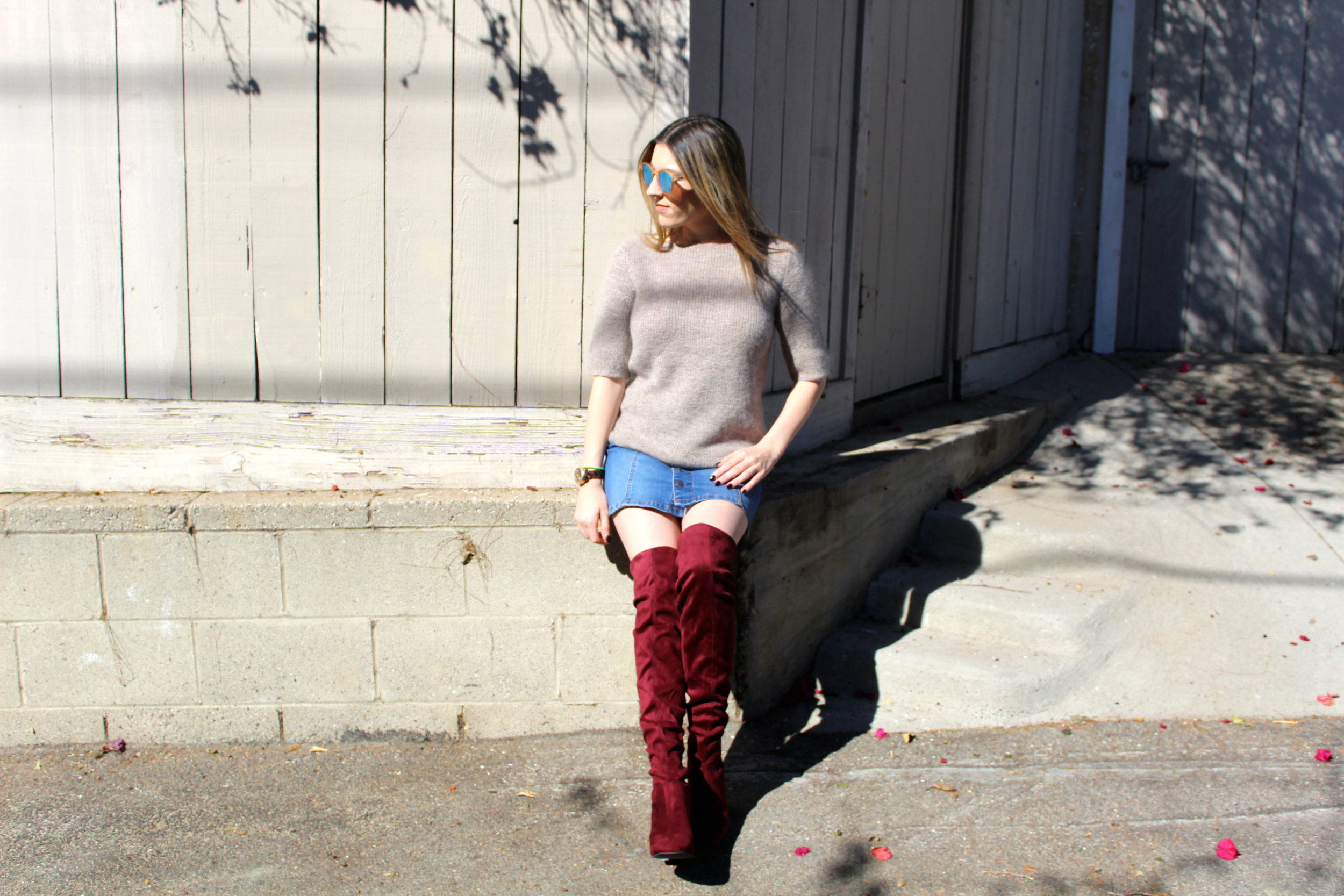 Boots:  New Look  // Skirt: American Rag,  similar here  // Sweater: Banana Republic,  similar here   // Sunnies: Le Specs,  similar here   Over the knee boots are one of the hottest shoes for the fall and winter season, and these red ones are to die for! In a previous post I shared all of my fall cravings, and these stunners were definitely on that list! I finally snagged myself a pair and oh how I love them! I decided this year to go with a pair that was an unconventional color like these red ones because I already own a brown pair and most likely will be adding a black pair to my closet. These type of boots can dress up the simplest of outfits and make anyone wearing them feel like a million bucks! I chose to style this look with a cute little button down denim skirt and an oversized mohair sweater, which I love! I really wanted these boots to stand out and be the sexy little stars that they are! Finally I put on my new mirrored Le Specs sunglasses, another new closet fave! This look is absolutely one of my favorites and screams fall to me. Wear and repeat is my new motto with this look!   Thanks for reading!  xx Nicole