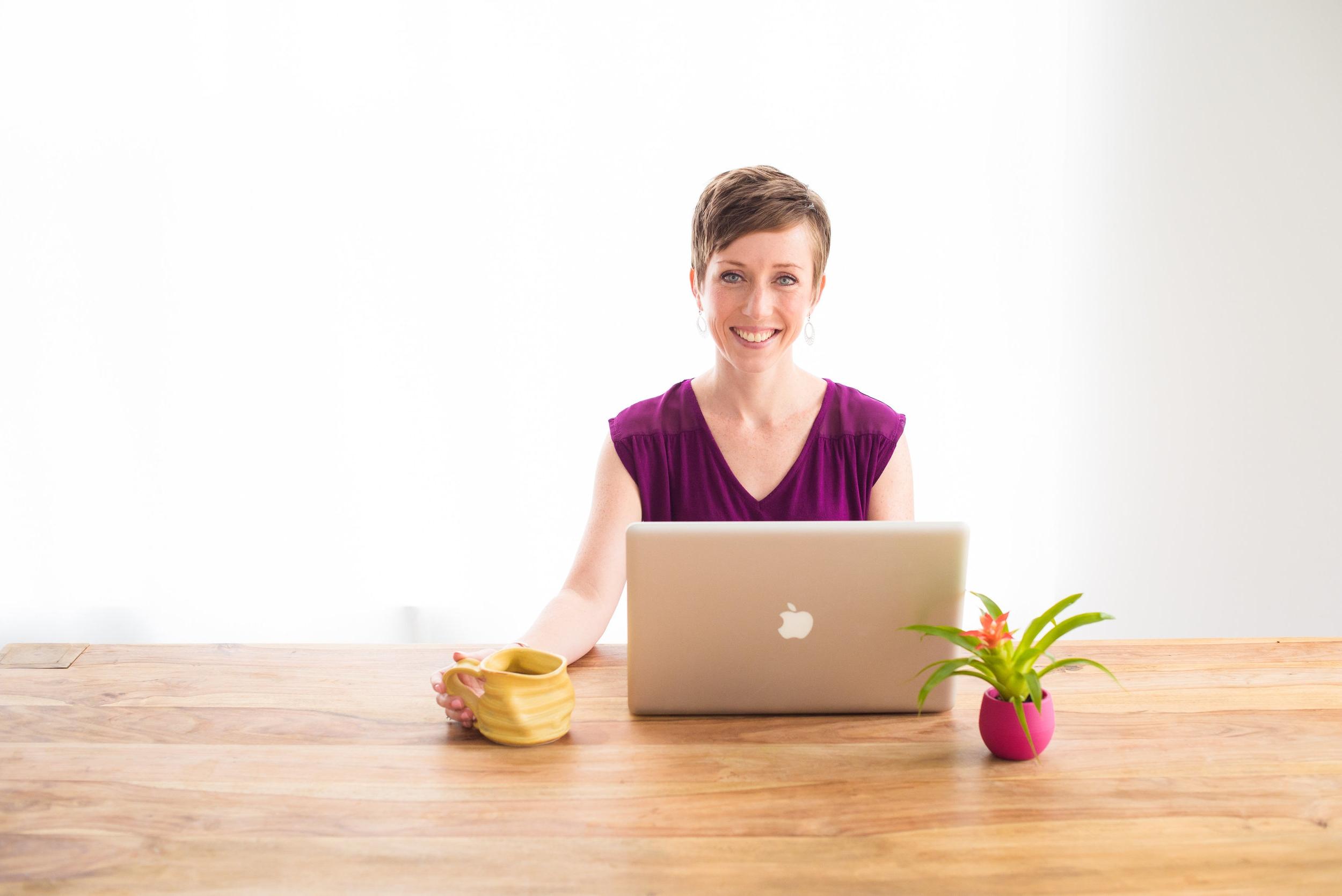 Horizontal - desk, hand on mug.jpg