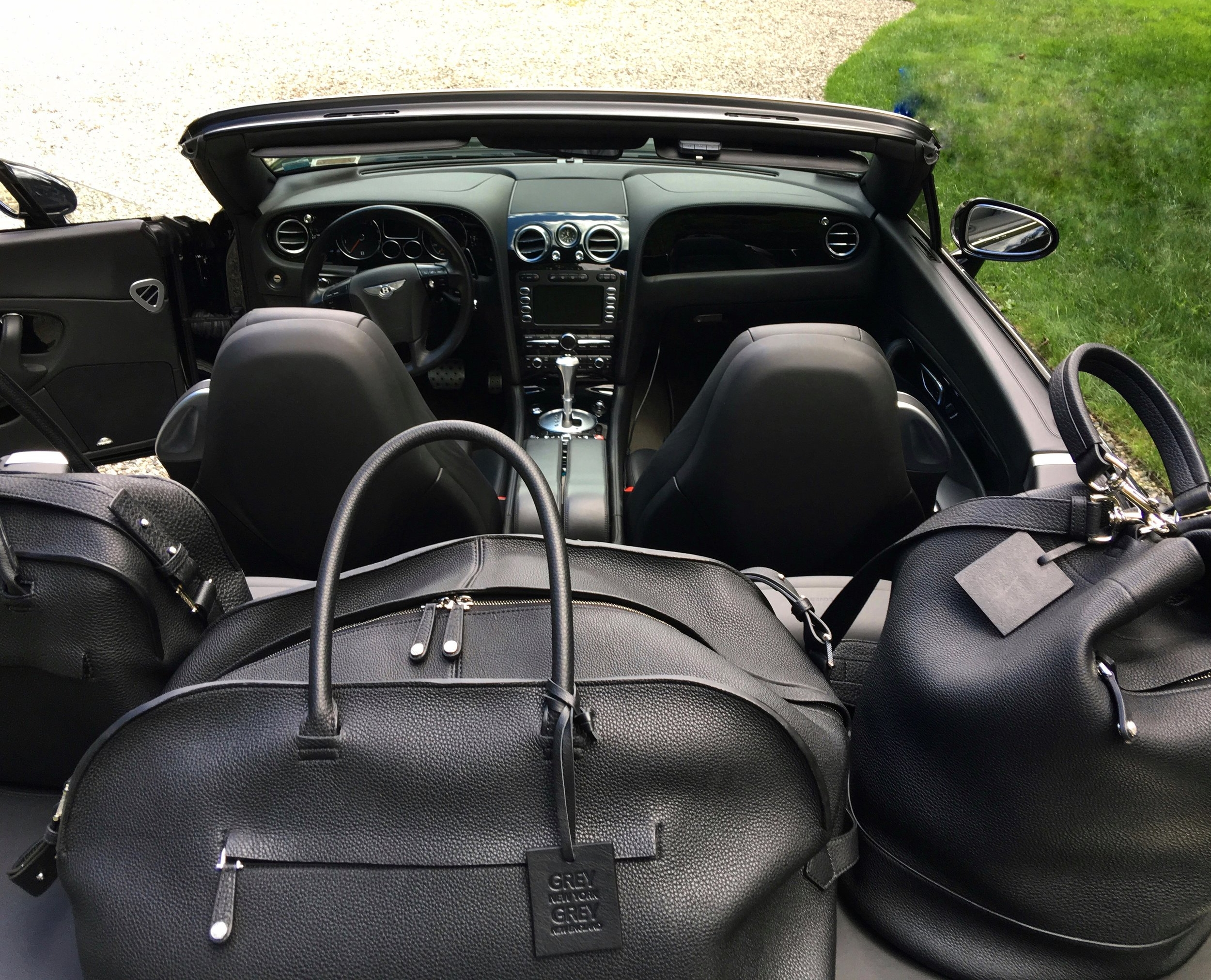 Grey New England Briefcase, Duffle, and Bucket