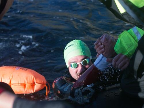 Robbie getting hauled out of the water - Saltstraumen Swim - Credit to Erlend Bodo Nu.jpg