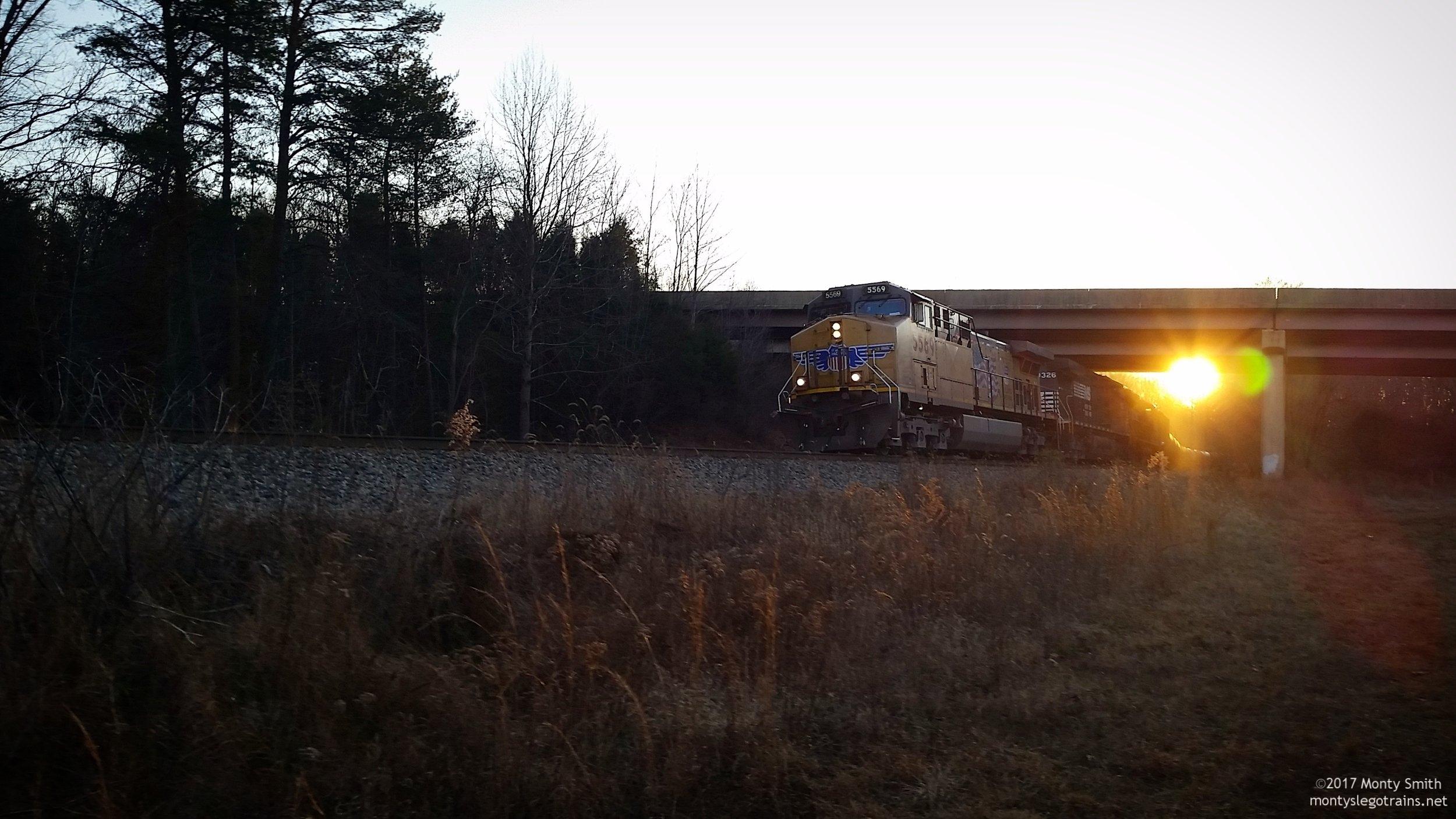 64A roars up the hill through Fairfax Station, VA at sunset.
