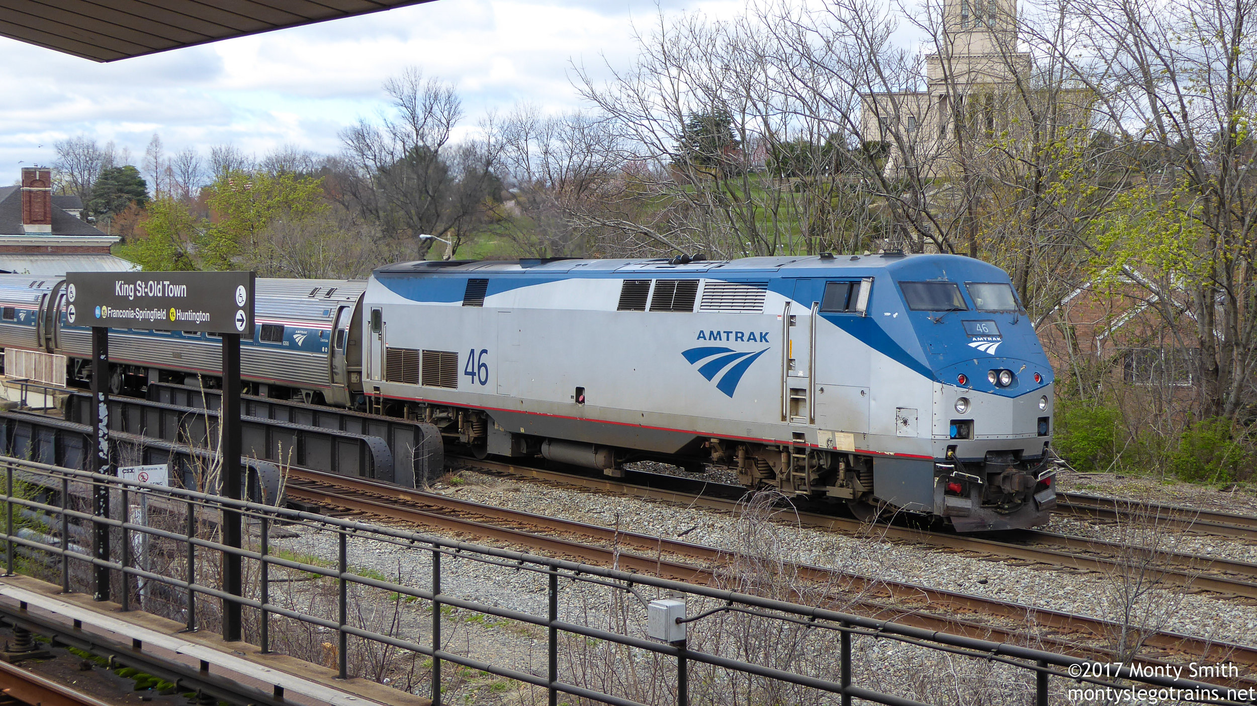 An Amtrak train pauses at Alexandria Union Station in Virginia, seen from the King Street Station of the Washington Metro System.
