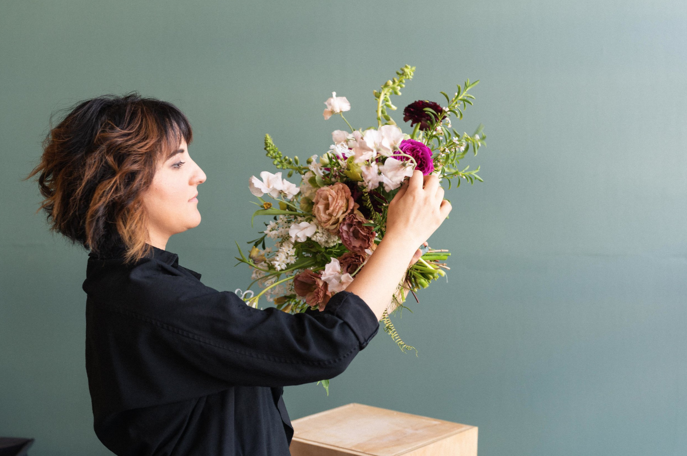 Amy has 20 years of experience working with flowers etc. -
