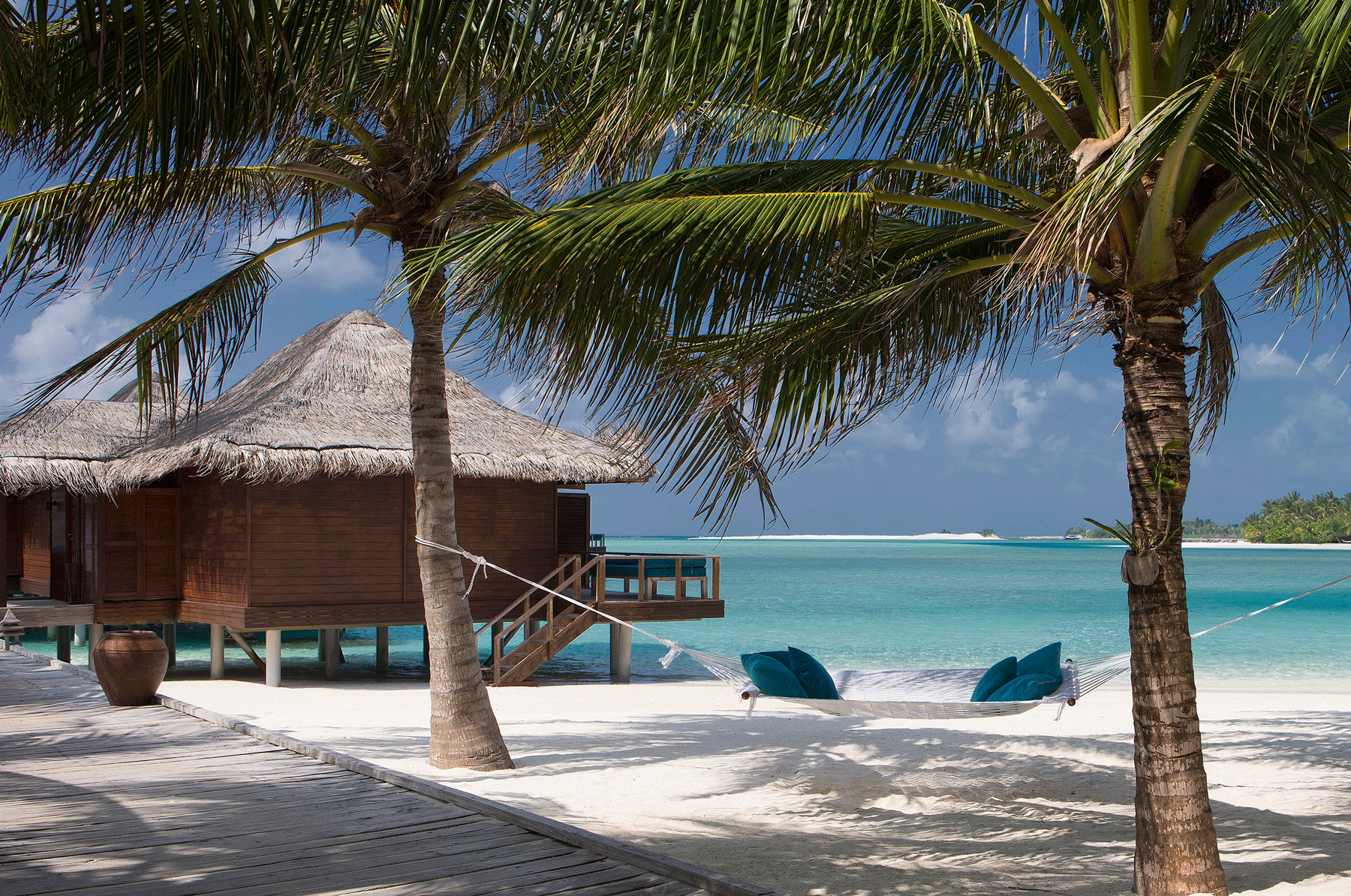 61912005-H1-Boardwalk_from_beach_to_Over_Water_Bungalows-copy.png
