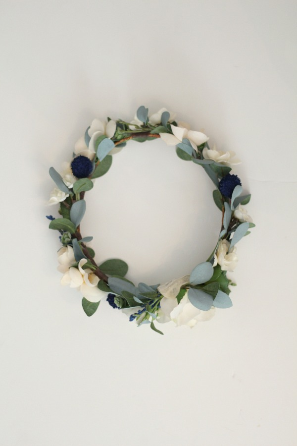 A custom  Sienna Crown  with added cream florals all around, blue thistle and a bit of succulents.