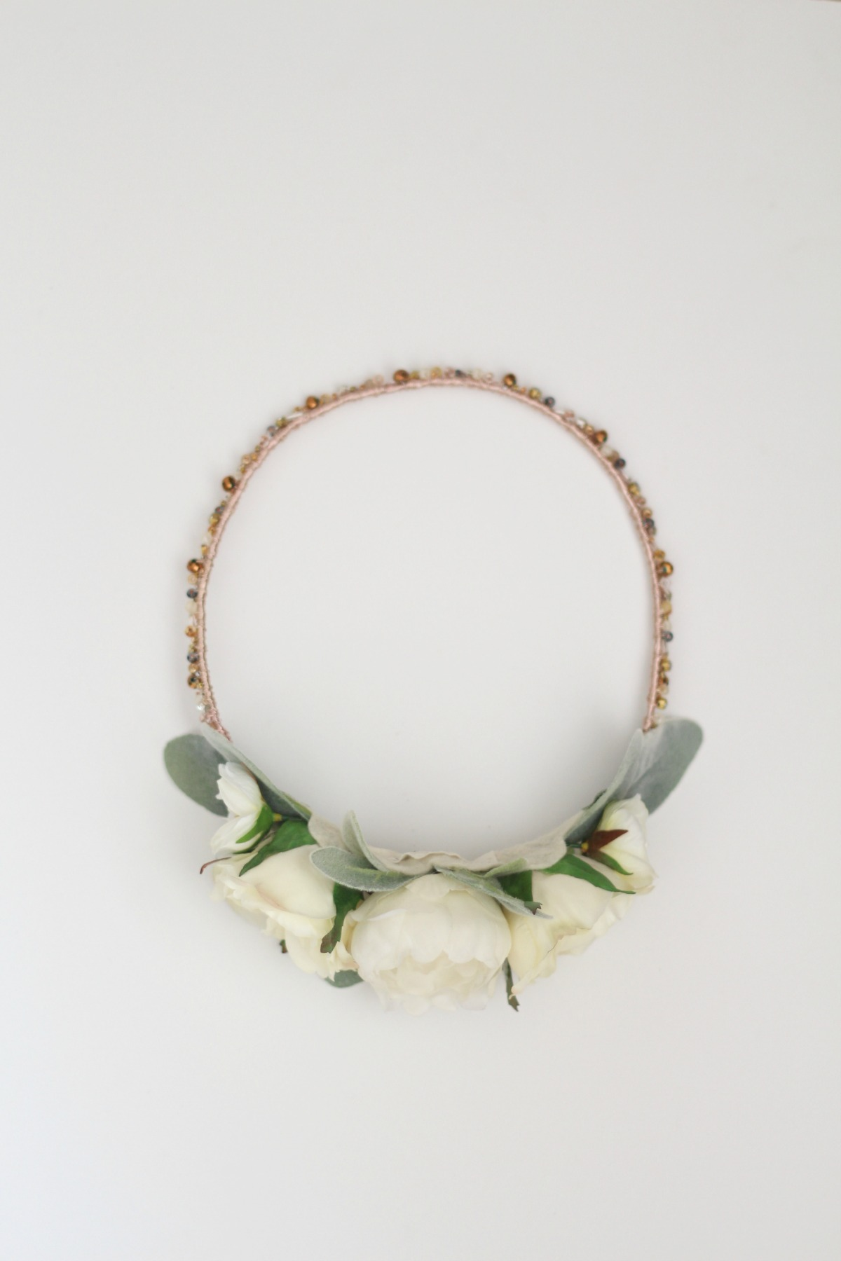 A custom  Sadie Crown  with a collection of smaller cream florals in the back