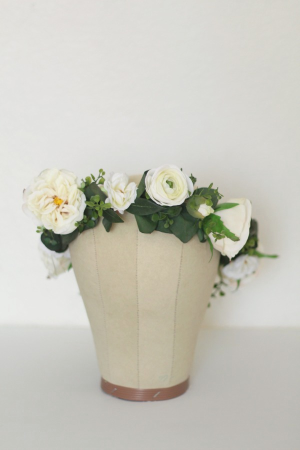 A custom  Laina Crown  created with cream and white blooms