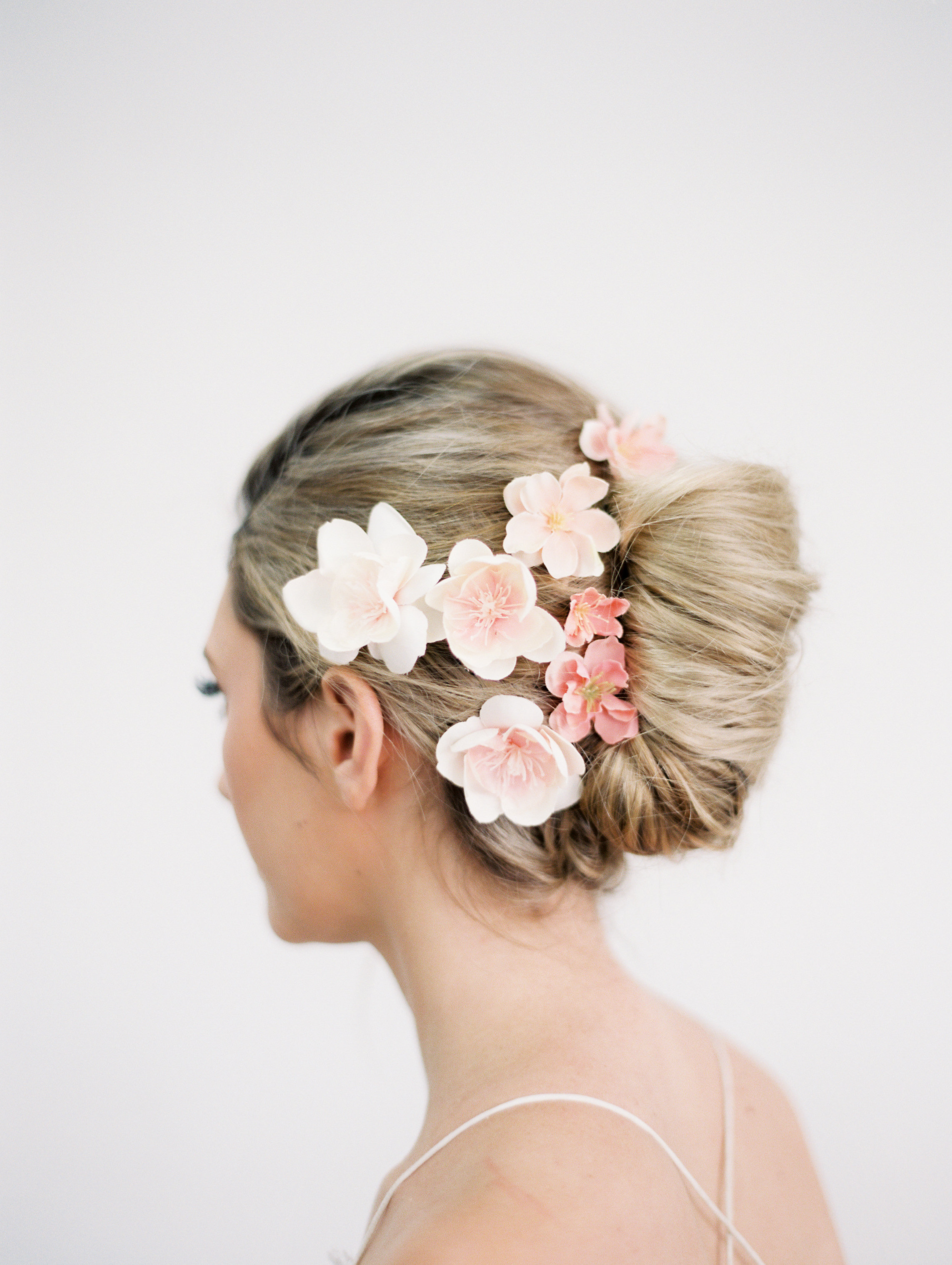blush-pink-flower-clips-bridal-hairstyle-updo