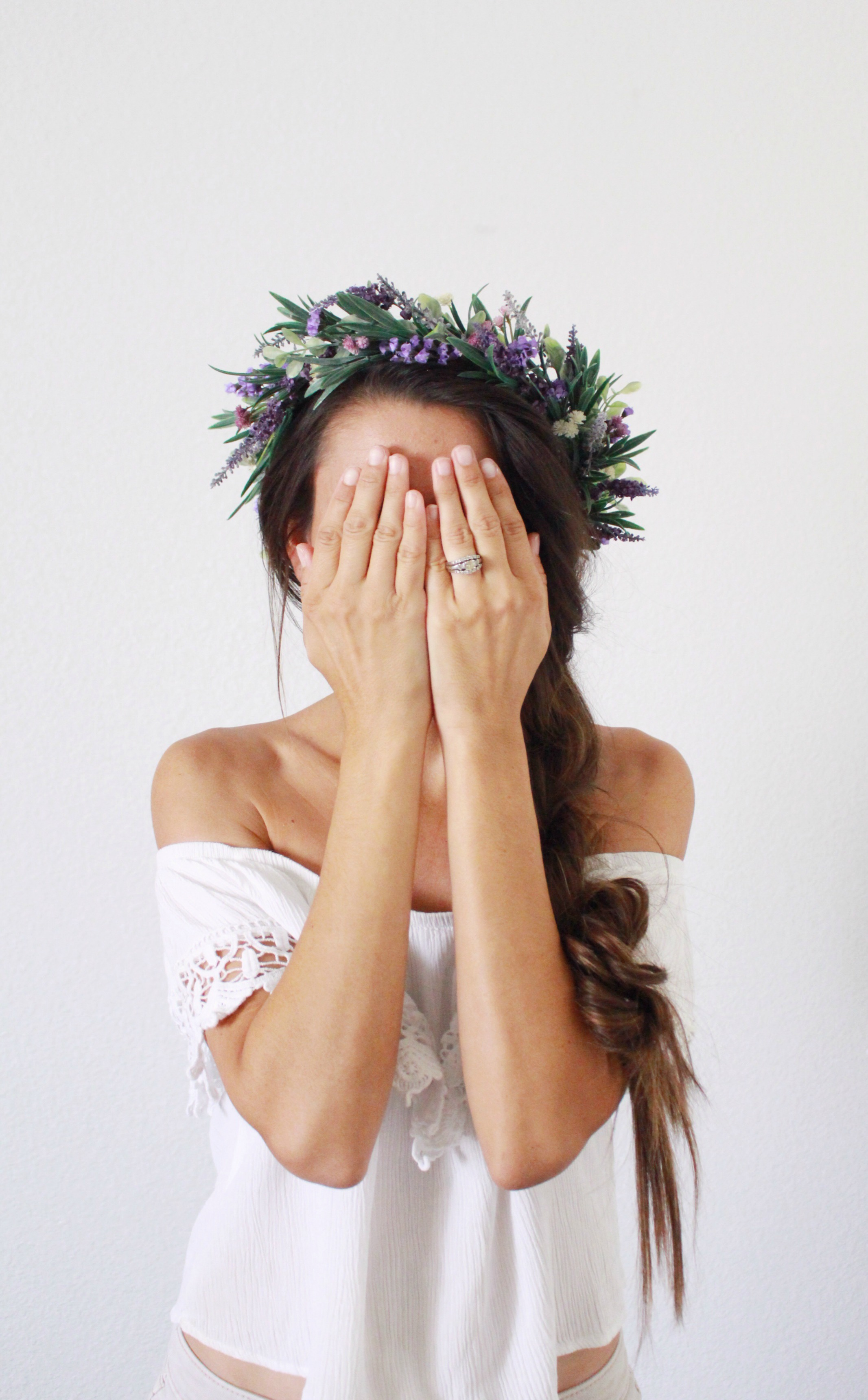 braided hairstyle with flower crown. diy lavender flower crown. flower crown style. hairstyle. long hair floral crown.