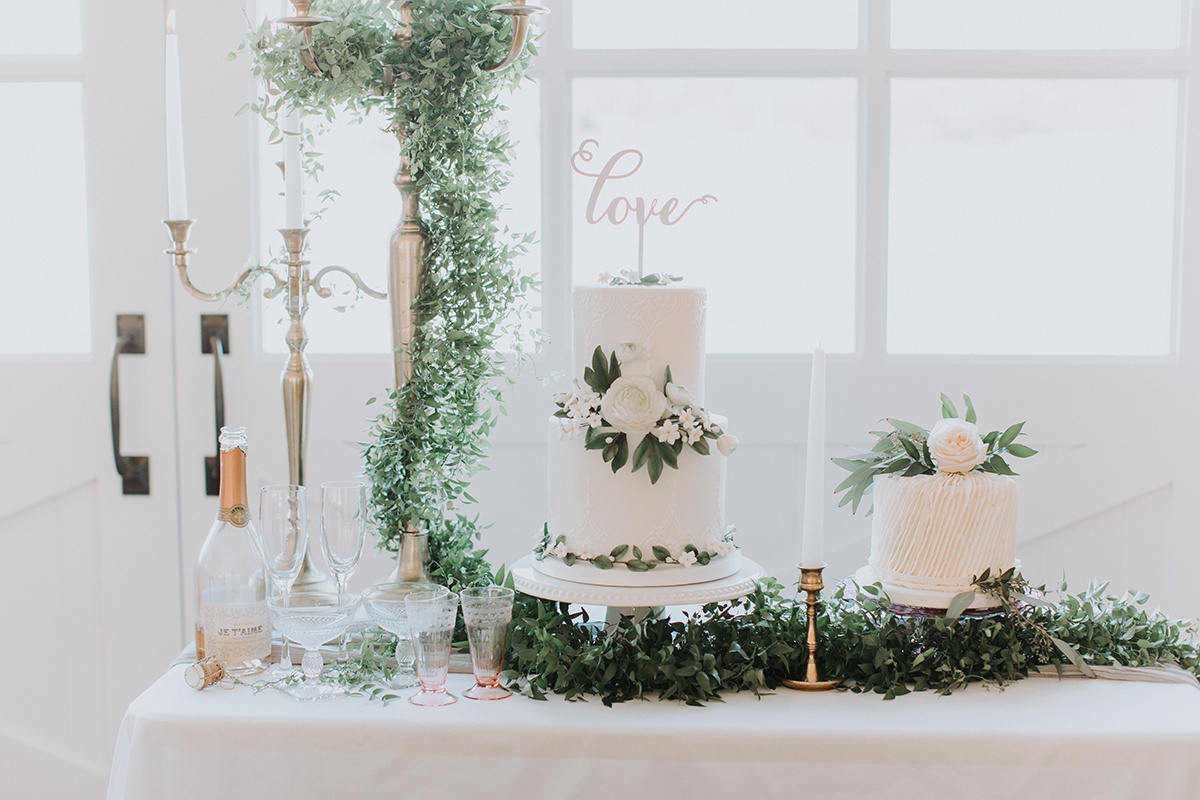 winter wedding dessert table with greenery details