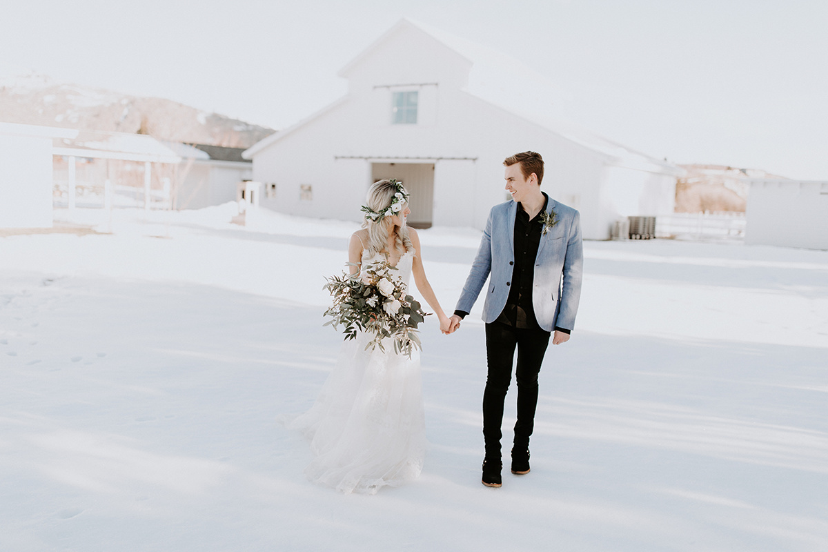 Winter barn wedding bridal style with flower crown hairstyle. White and greenery floral crown by Love Sparkle Pretty.