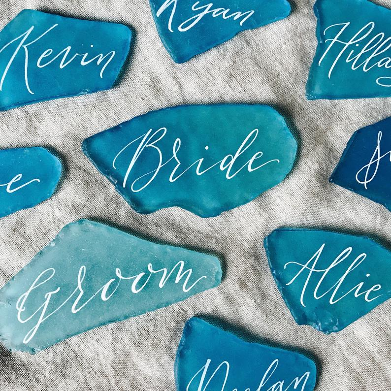 coastal wedding decor ideas calligraphy sea glass guest name cards