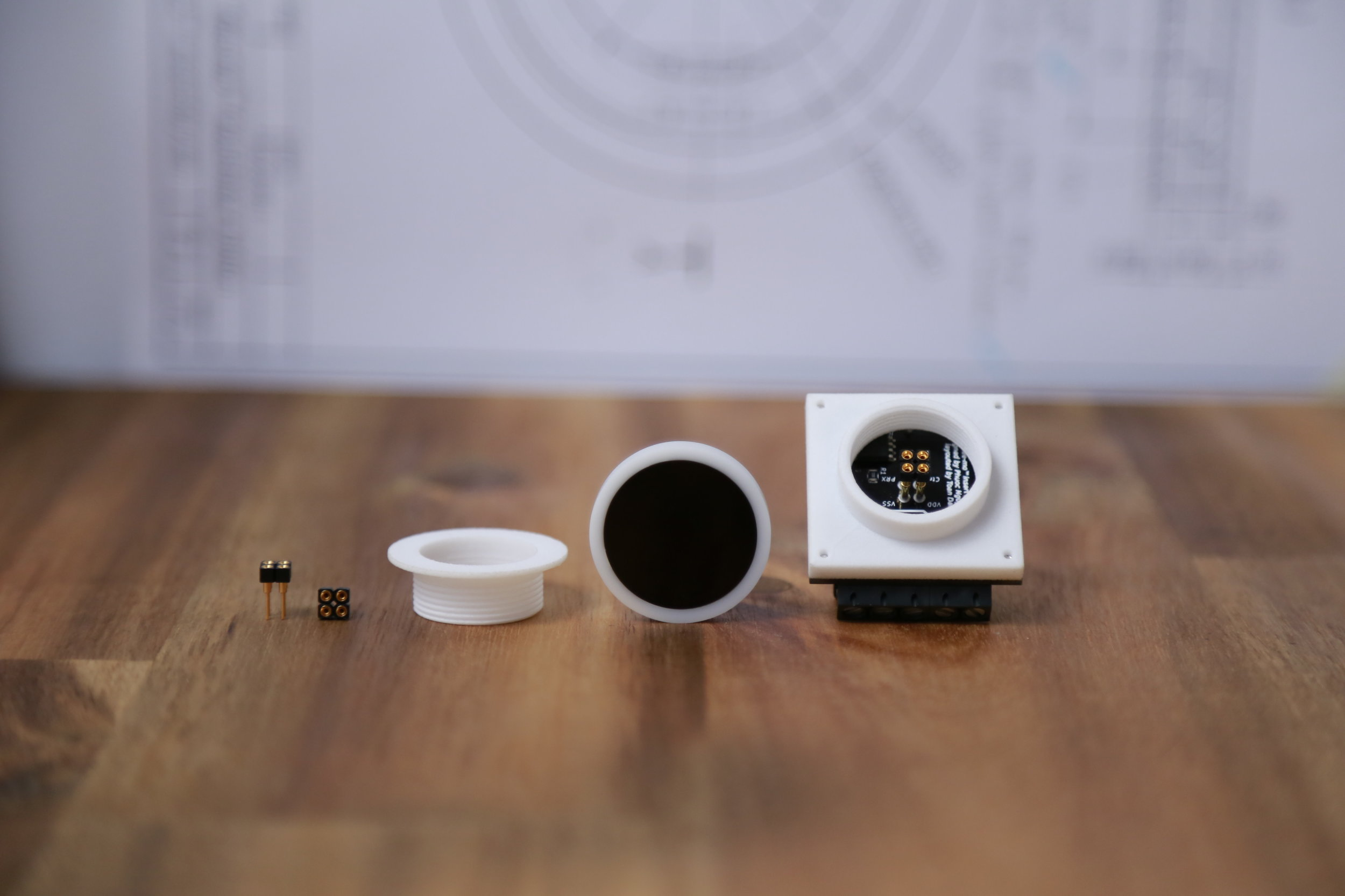 Parts identification of the flee-mo™ touchless switch  (From left)  2 x interconnect socket strips, 3D printing threaded cap, UI and insert with case