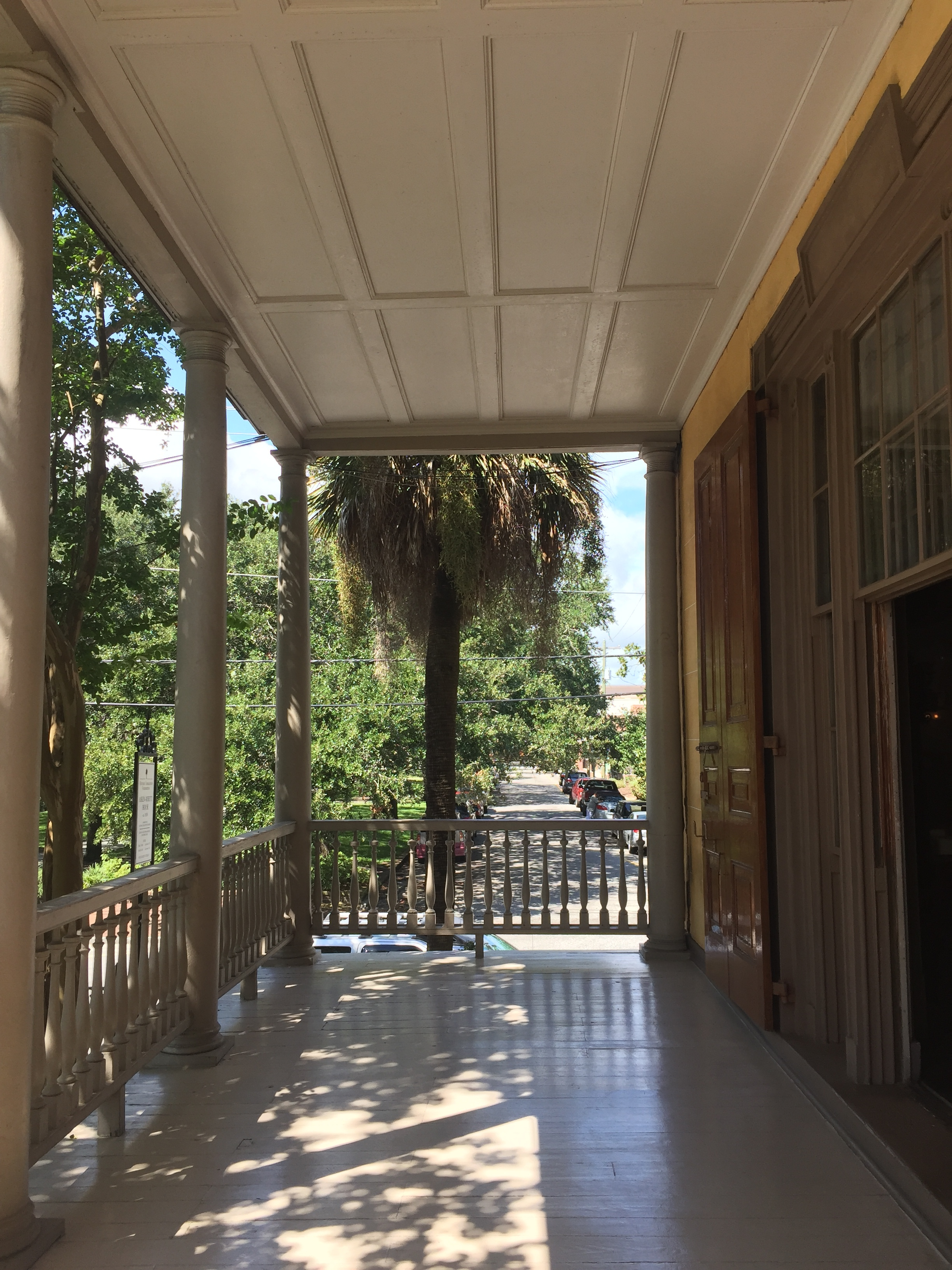 The columns of the porch are doric in character with turned baluster railings. The single hung windows transform into doorways that allow you to walk onto the verandahs. These windows are advantageously placed to allow for a cross breeze through the house and are extremely common in the South.