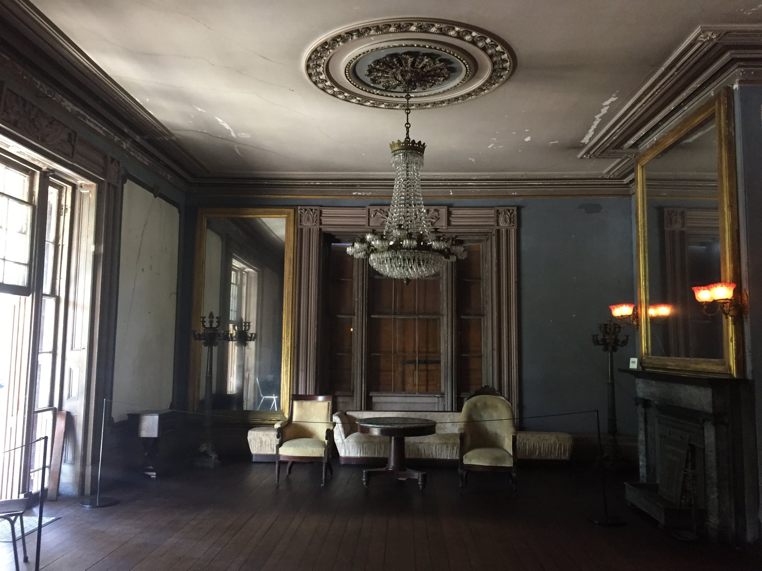 Once operating as the main entrance of the home now resides two symmetrical parlors divided between two pocket doors. The character and details of the house are popularly known as Greek Revival.