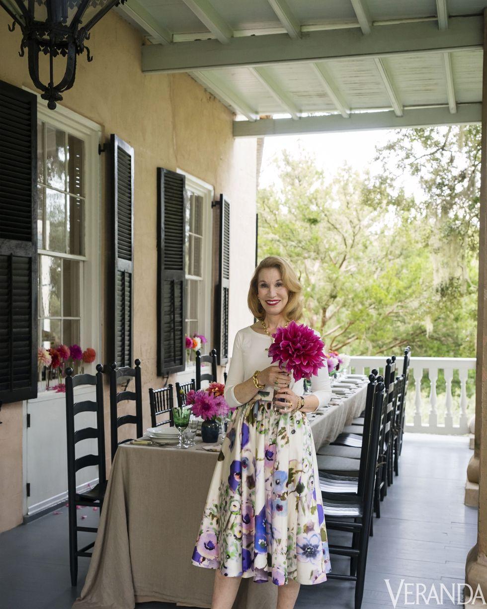 Elizabeth Locke, on the porch of her vacation home  Photo captured by Veranda Magazine