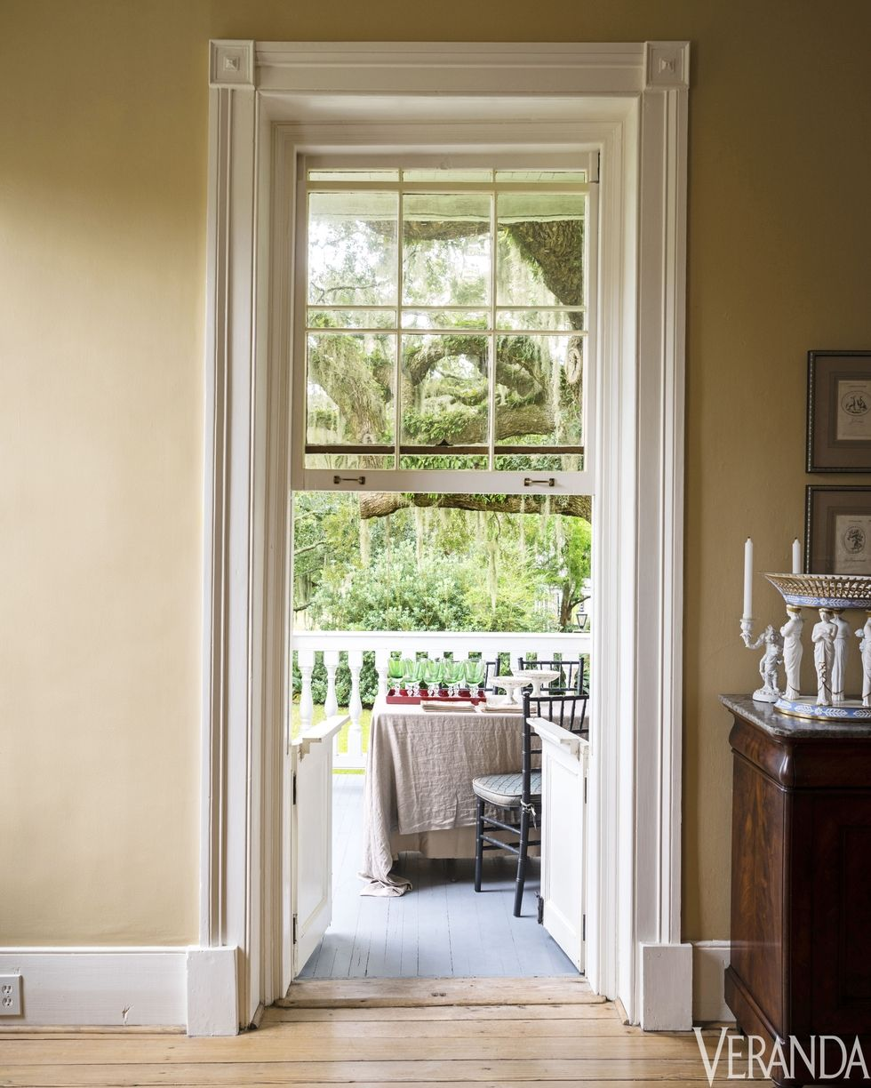 Large window opens out onto the front porch  Photo captured by Veranda Magazine