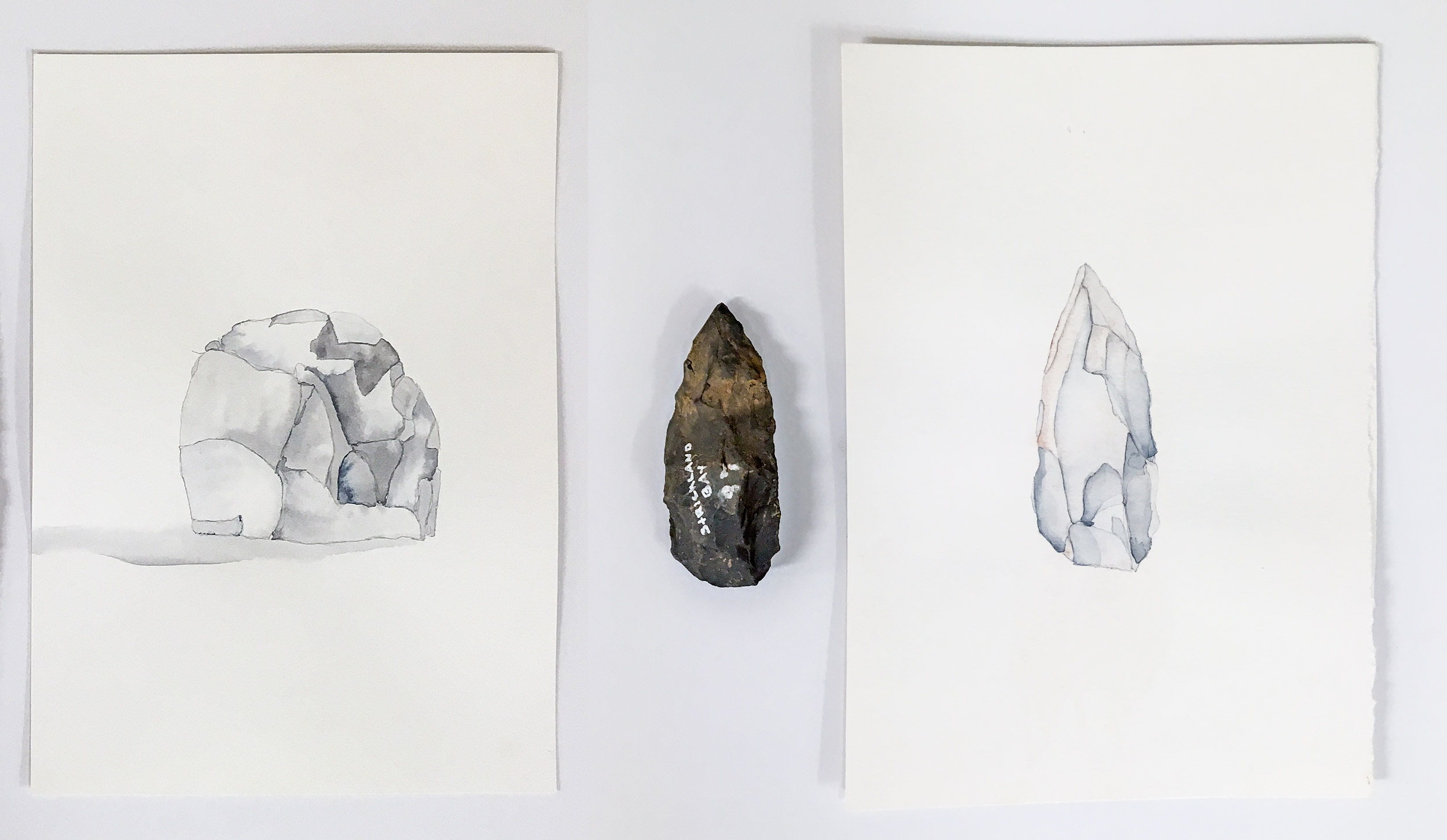 Intended exhibition display. Purpose is to show you how exhibited artworks and stone tools can sit together within an exhibition space. These are Water colour paintings of the stone tools. 2016/17 size: A4. This painting process helped me to develop the idea of breaking the stones shards into separate printing plates. I understand this will be considered as two images.