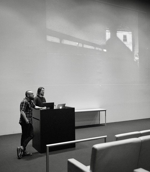 Flashback to Ford & Brown giving a talk on architectural photography at the @figgeartmuseum last year!  The image on screen is one of Ford's first still images form the first photography class he took in 1997! . . . . . #fordandbrown #architecturalnarratives #architecture #figge #davenport #iowa #tagtheqc