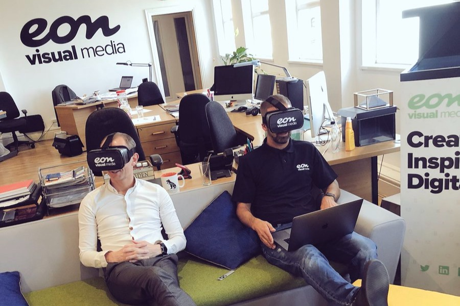 Managing Director Matt Dass and James Cherry, Head of App, Design and Web, modelling VR headsets.