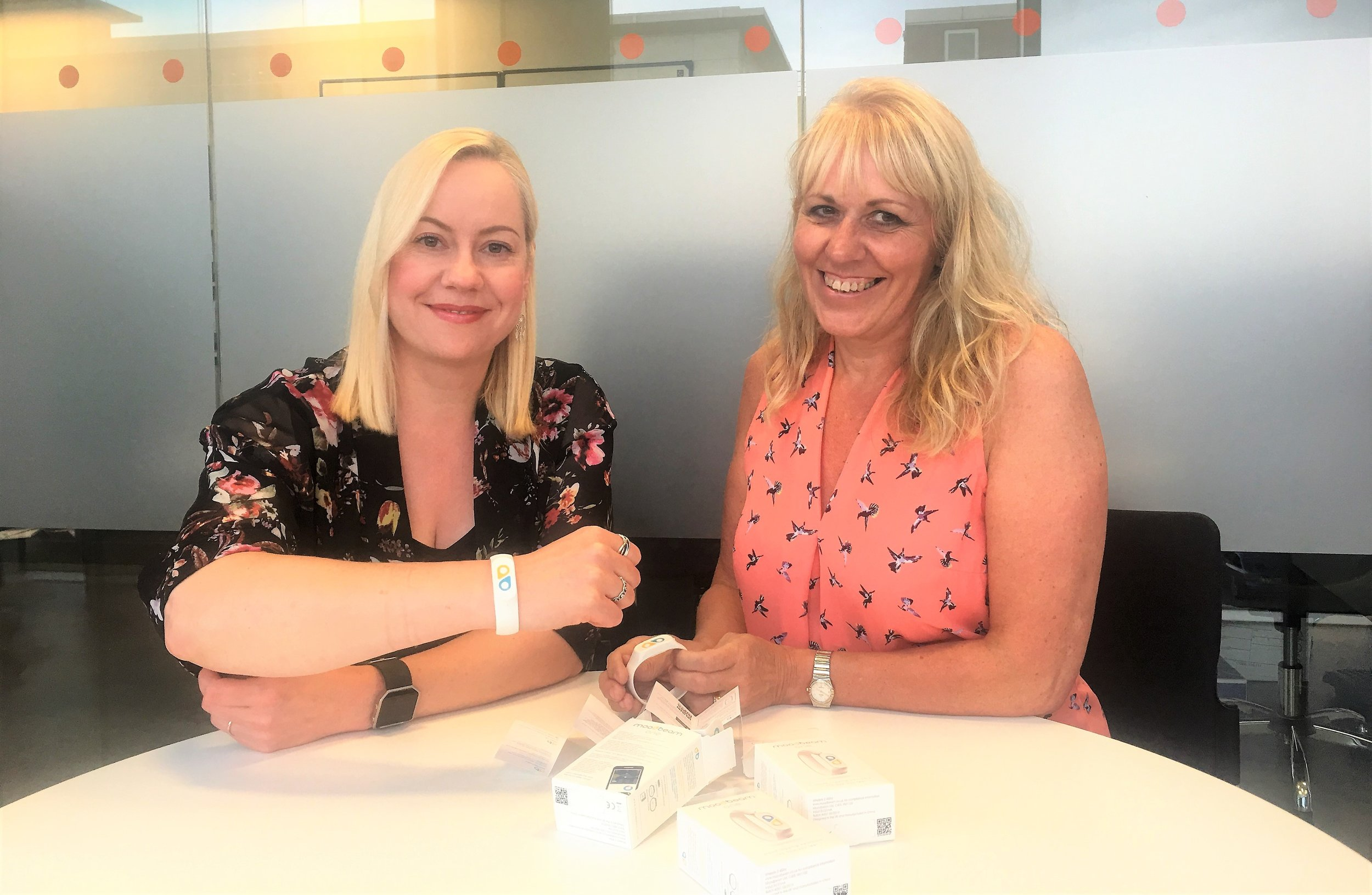 Spencer Group Training Administrator Sarah Jarvill, left, shows off her Moodbeam wristband with Human Resources Director Yvonne Moir. The company has become the first engineering business and among the first employers to adopt the pioneering device.