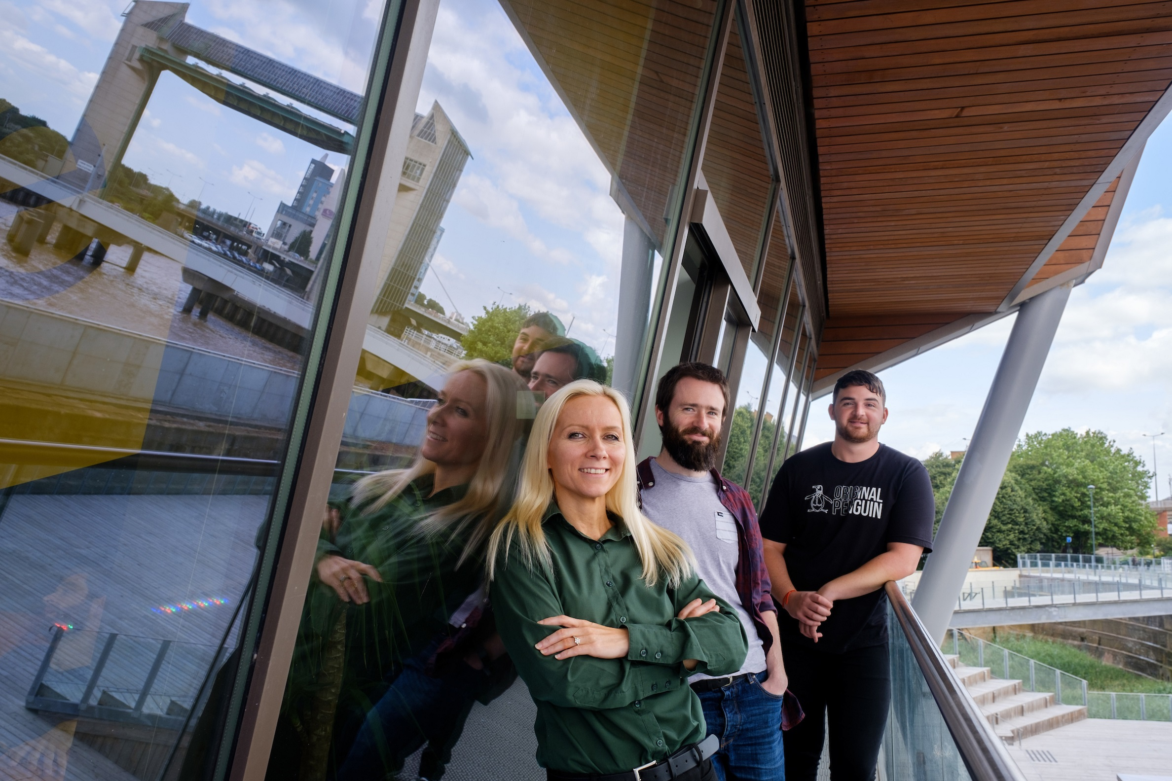 Sauce team members outside their office at the C4DI tech hub overlooking Hull's waterfront, from left, Director of Development Claire Clark, Lead Developer Aidan Treasure and Developer Danny Wilkinson.