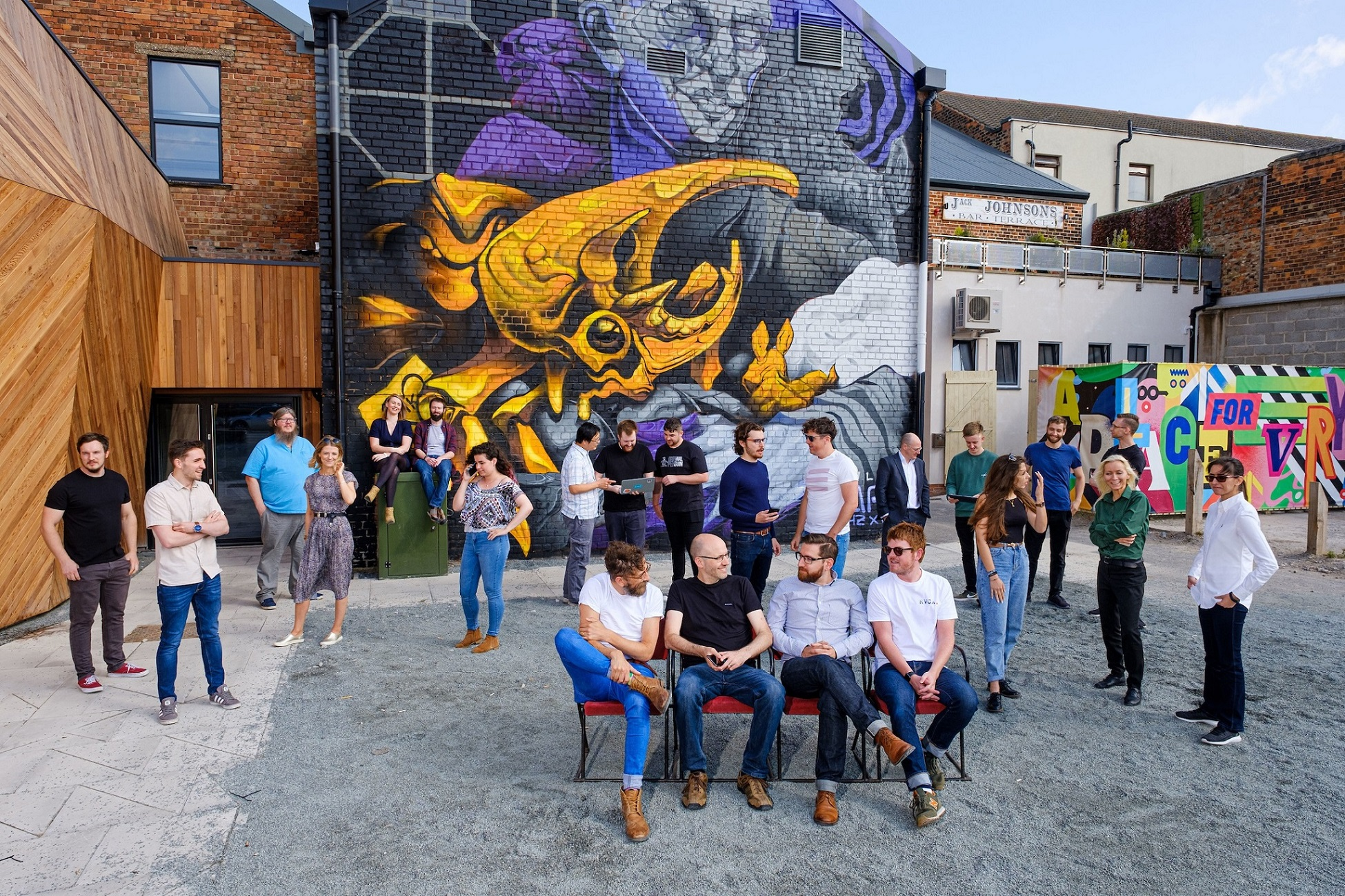 Sauce owners, seated, from left, Jim Wardlaw, John Polling, Matt Weldon and Matt Gibson with team members in Hull's Fruit Market urban village where the fast-growing smart tech business has its home.