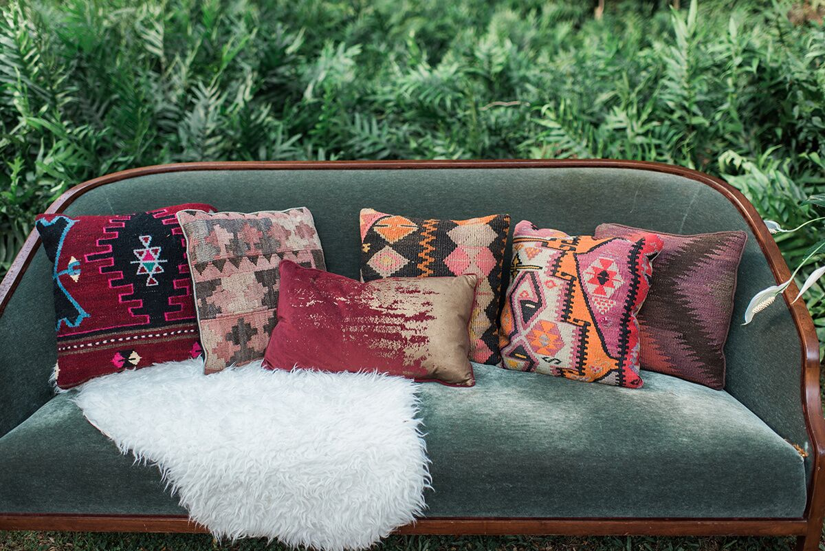 Emerald Velvet Sofa ,  Pillows , &  Faux Fur Sheep Skin   Photo Courtesy of  Rae Marshall