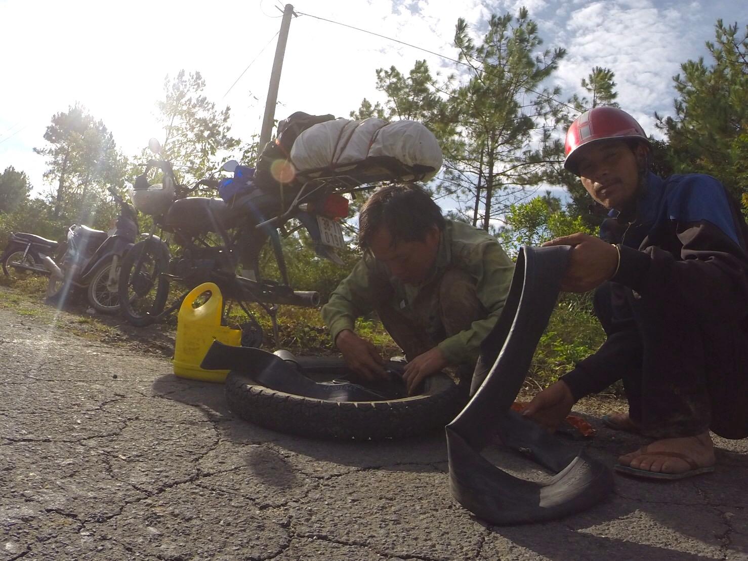 Fixing a flat tire near Kontum