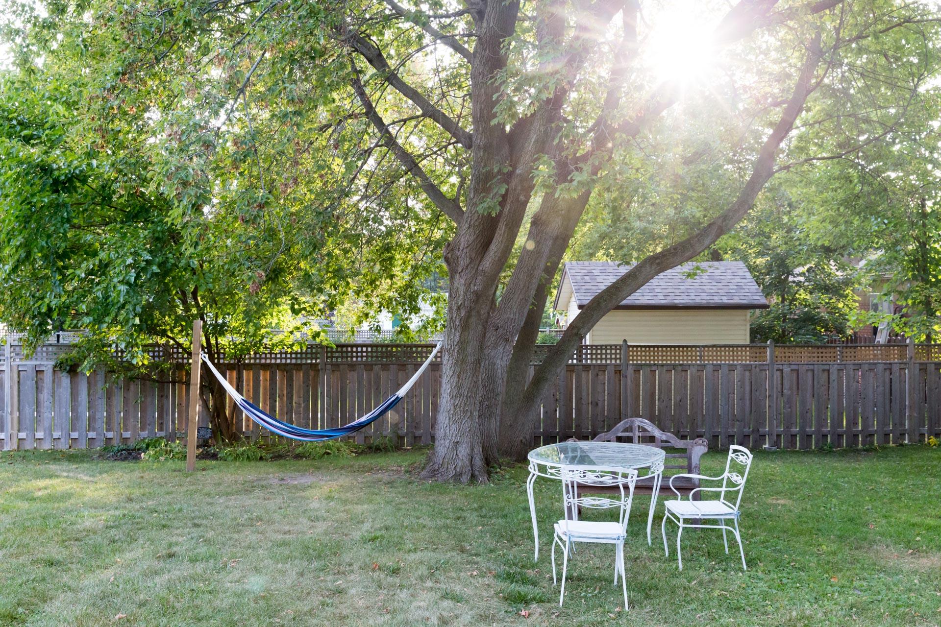 hammock hanging beside a patio set in The Ferg backyard