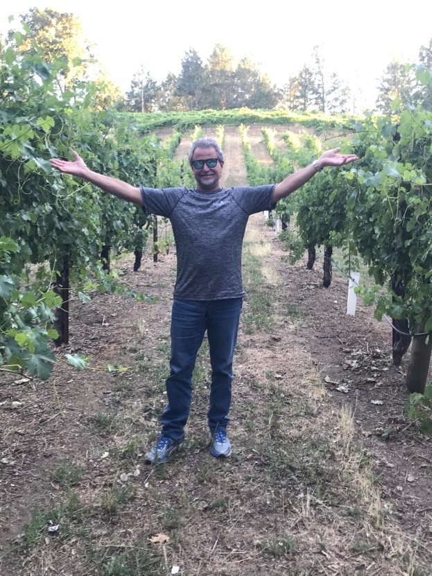 Adobe Road Winery Owner Kevin Buckler among the Viognier vines @ Famgihetti Vineyards.