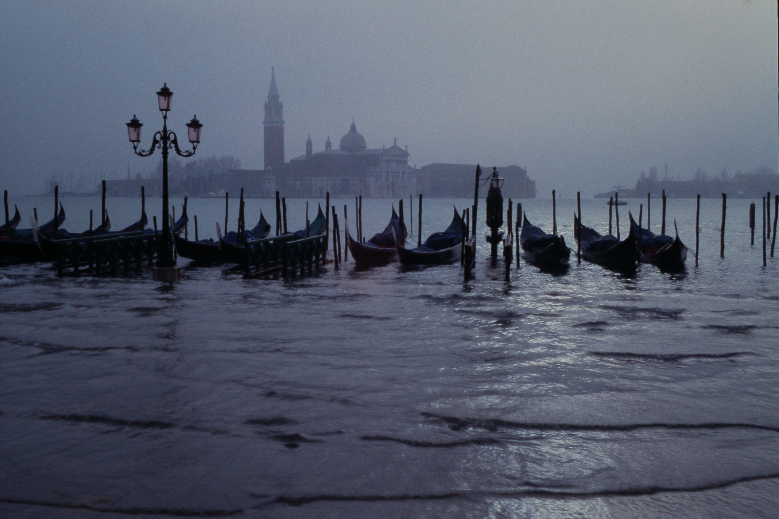 Venice at night with San Giorgio Maggiore seen from the flooded Piazza San Marco by Jorg Bittner via  Wikimedia Commons