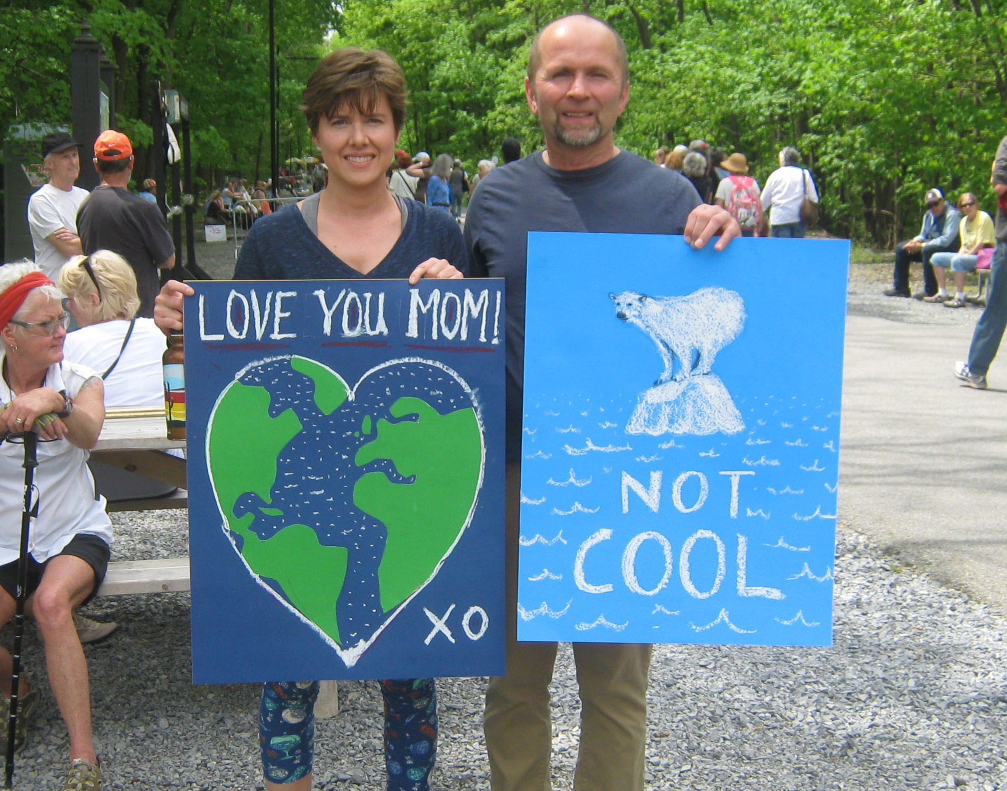 With hand-drawn signs, at the People's Climate March on the Walkway over the Hudson.