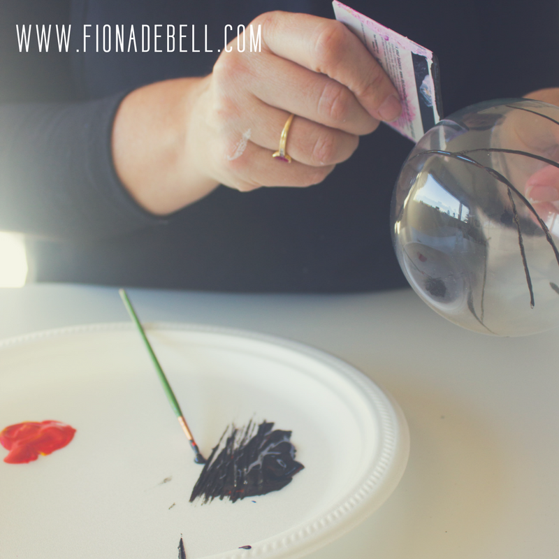 Apply Paint to a clear bauble using an old gift card. | fionadebell.com