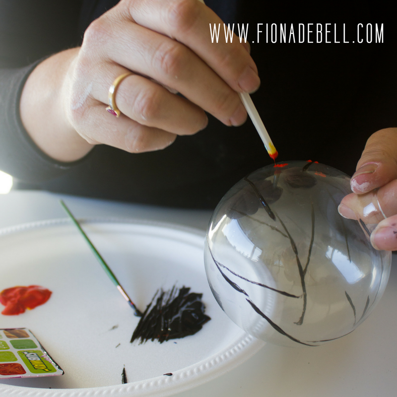 Use the non-bristle end of your brush to add the 'berries' to your ornament. | fionadebell.com