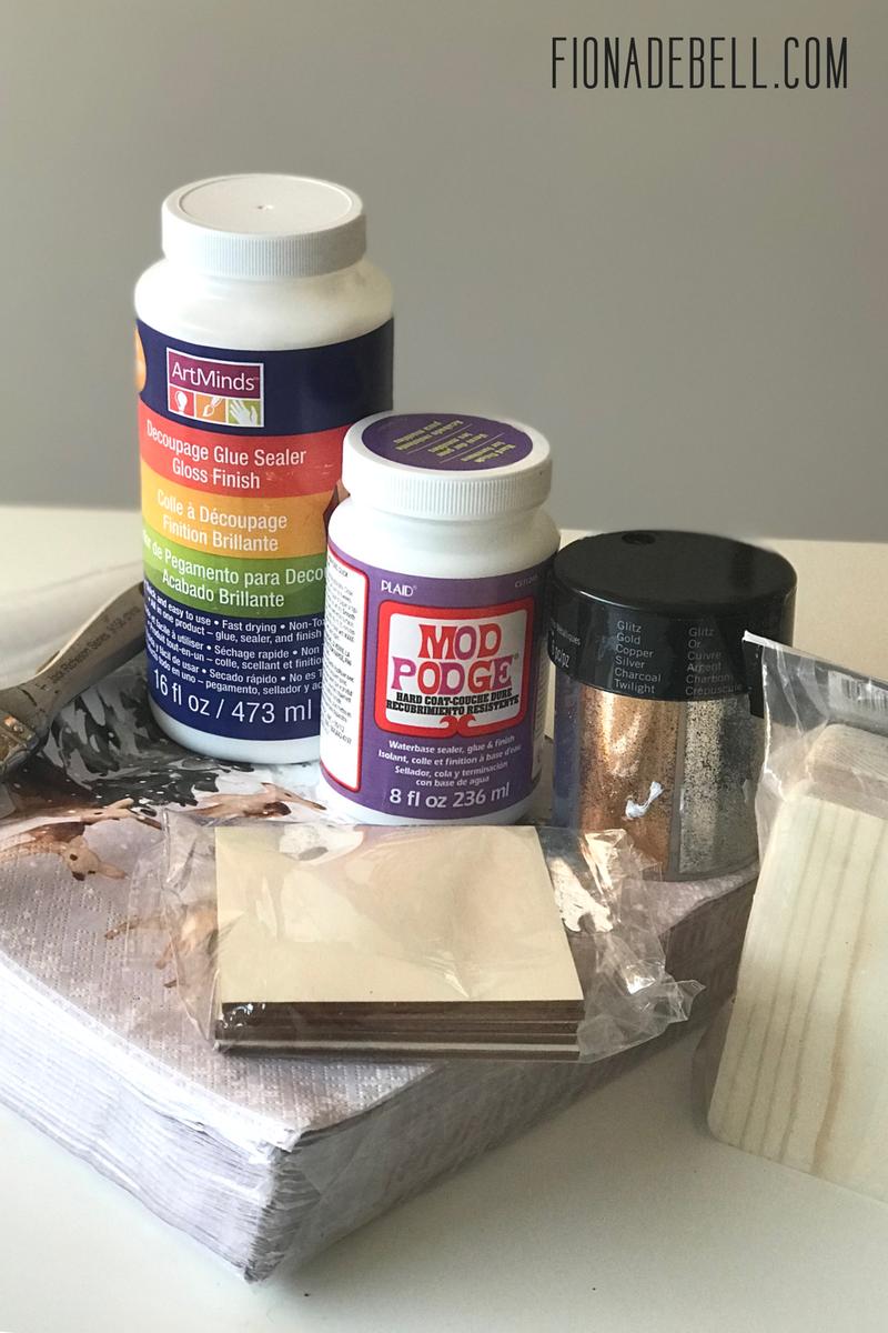 Glue, napkins, wooden coaster blanks, glitter. | fionadebell.com